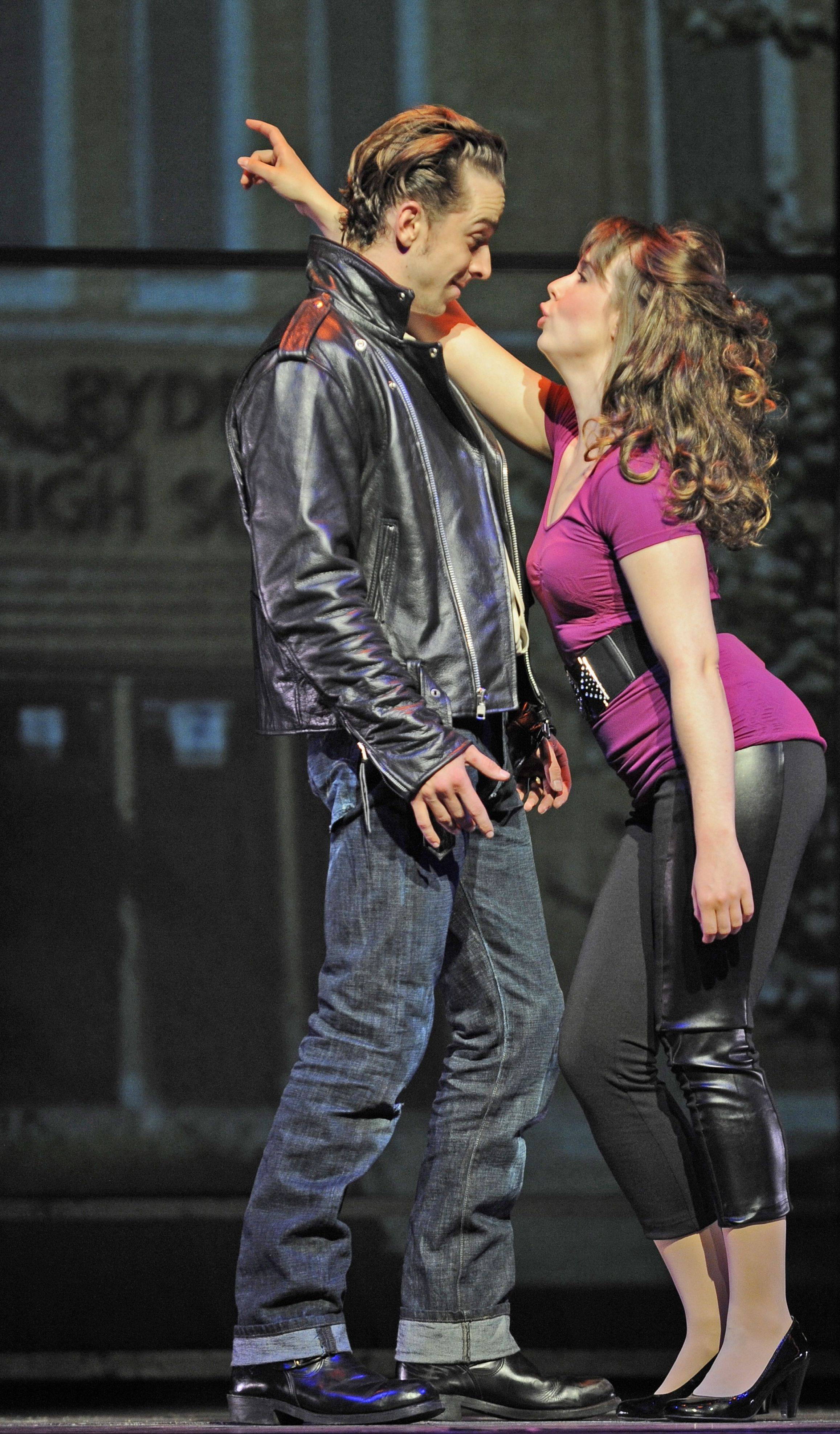 "Danny Zuko (Skyler Adams) and Sandy Dumbrowski (Emma Ritchie) sing ""All Choked Up"" in ""Grease"" at the Paramount Theatre in Aurora."