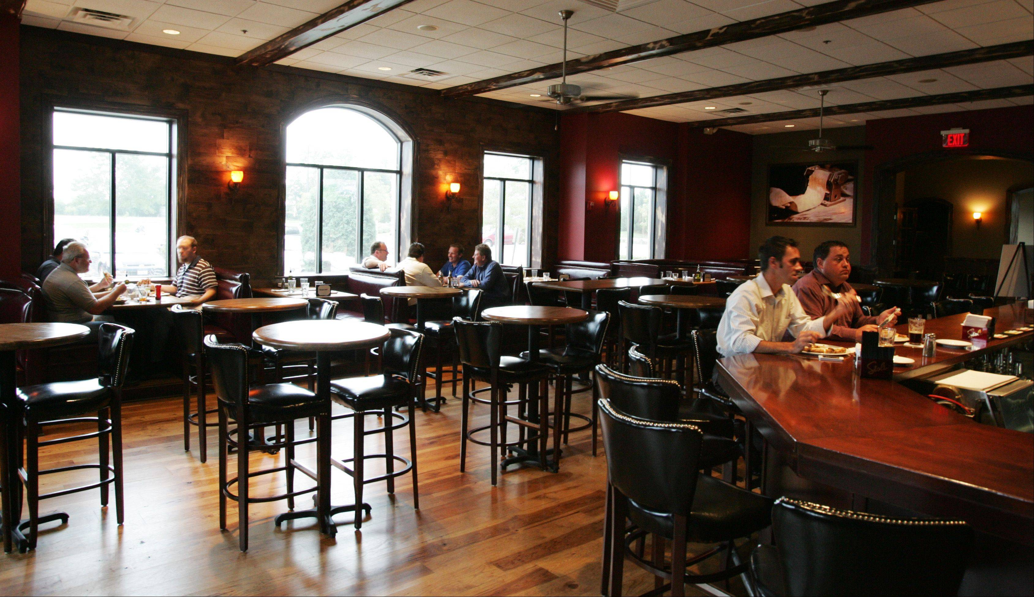 Customers eat in the spacious bar area at Marzano's Wood Fired Italian restaurant in McHenry.