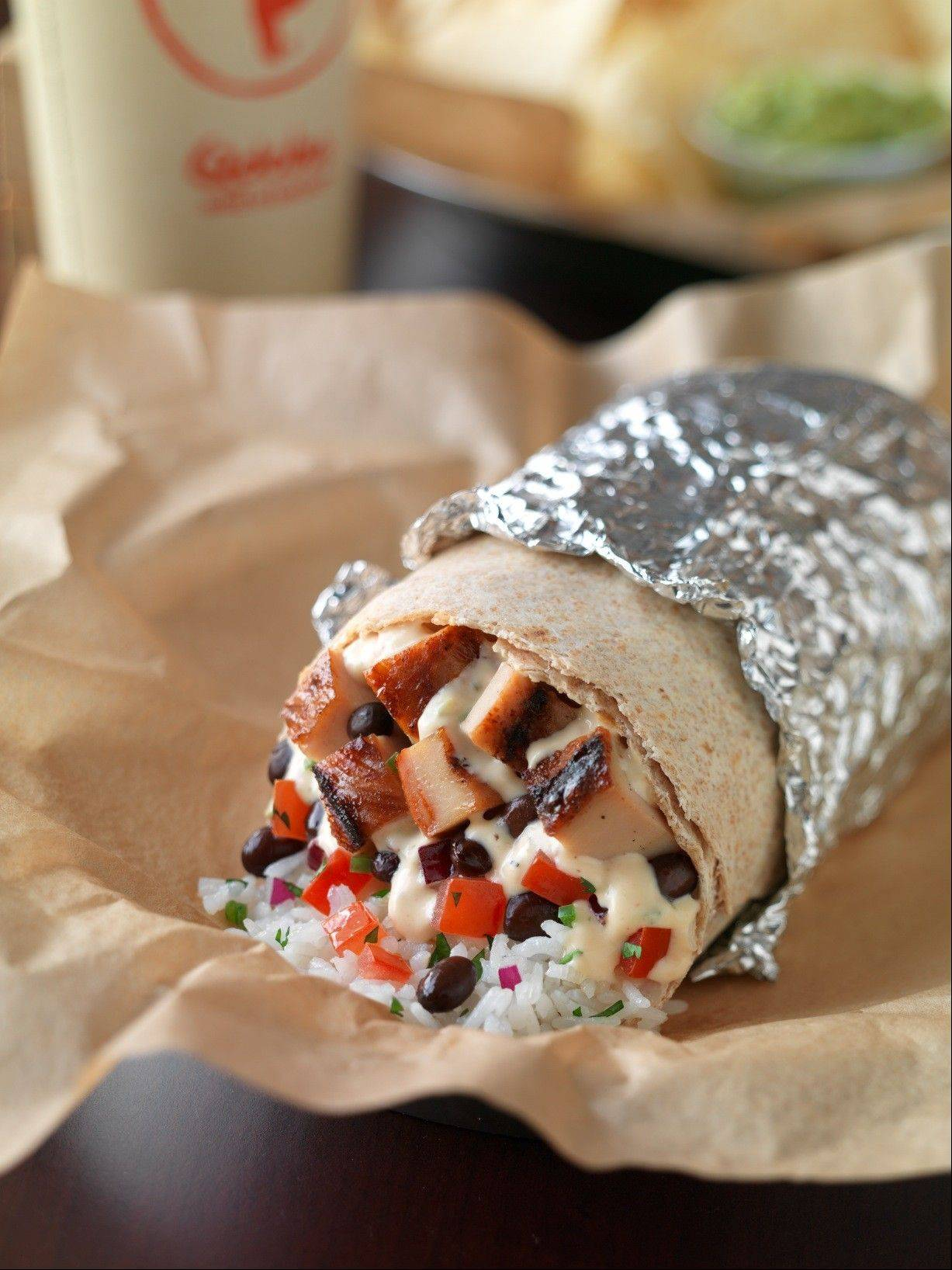Try Qdoba Mexican Grill's chicken queso burrito during a sneak-preview fundraiser to benefit Share Our Strength's Dine Out For No Kid Hungry campaign.