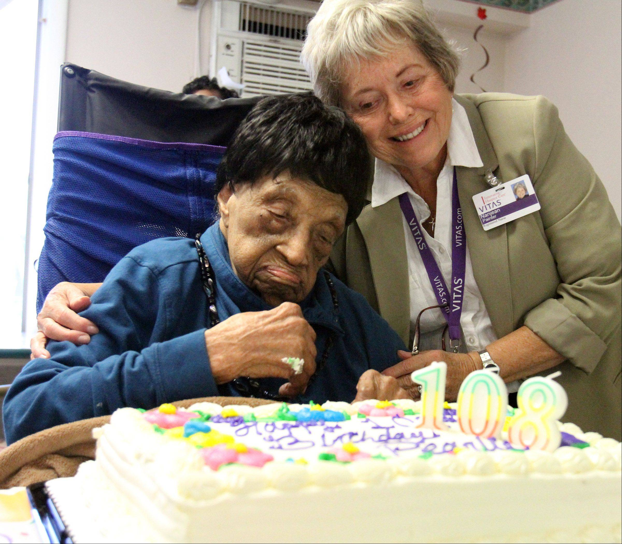 Pearlie Young gets a hug from nurse Nanjean Painter during Young's 108th birthday party Wednesday at Hillcrest Nursing Center in Round Lake Beach.
