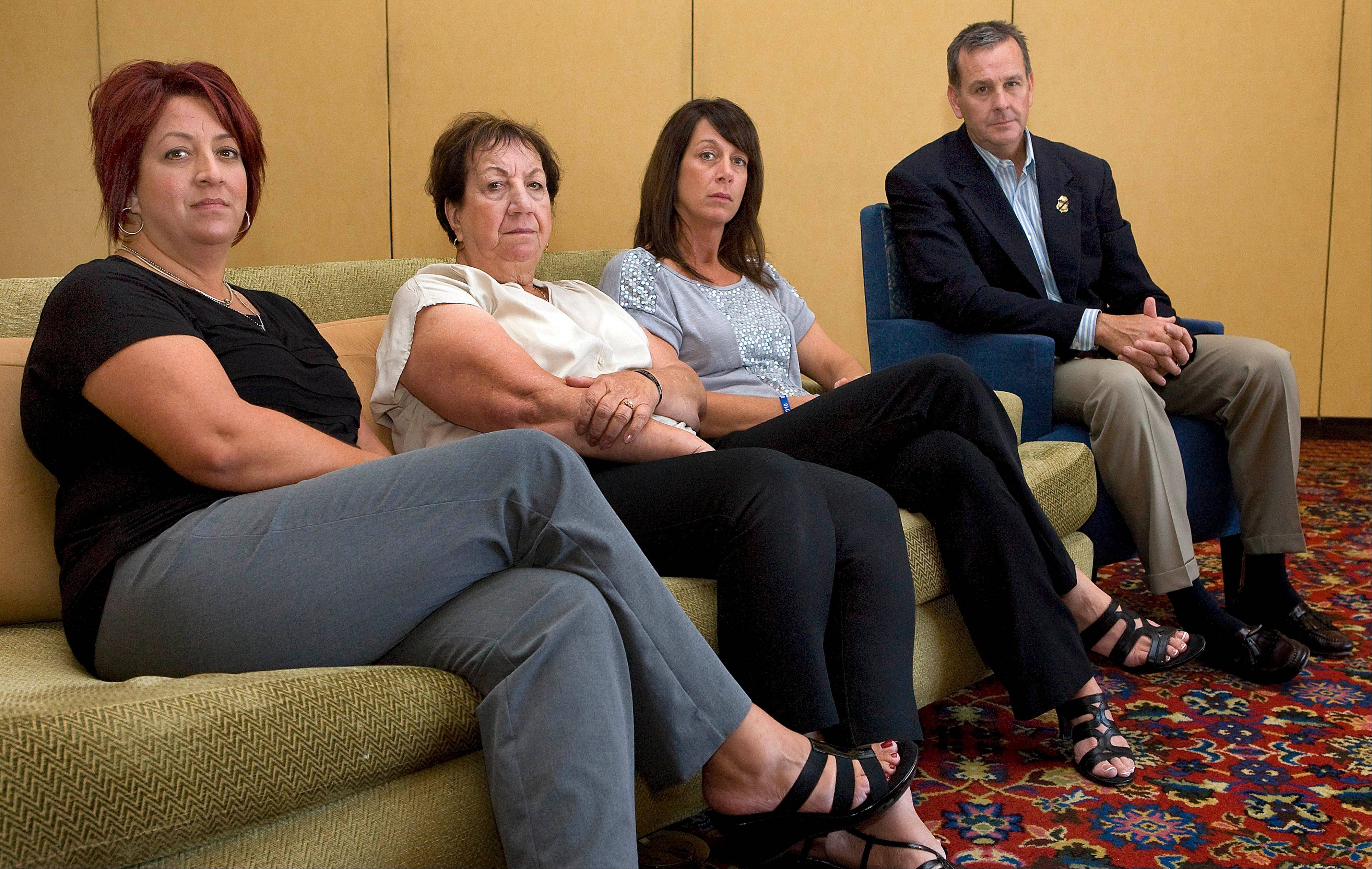 Members of Brian Terry's family, from left to right, Michelle Balogh, left, Josephine Terry, Kelly Willis and Robert Heyer, far right, pose at the Marriott-Starr Pass Resort in Tucson, Ariz., Sept. 16. Family members of Terry, an Arizona U.S. Border Agent killed in connection with a botched gun-smuggling operation, say they won't have closure until someone is held accountable for his death.