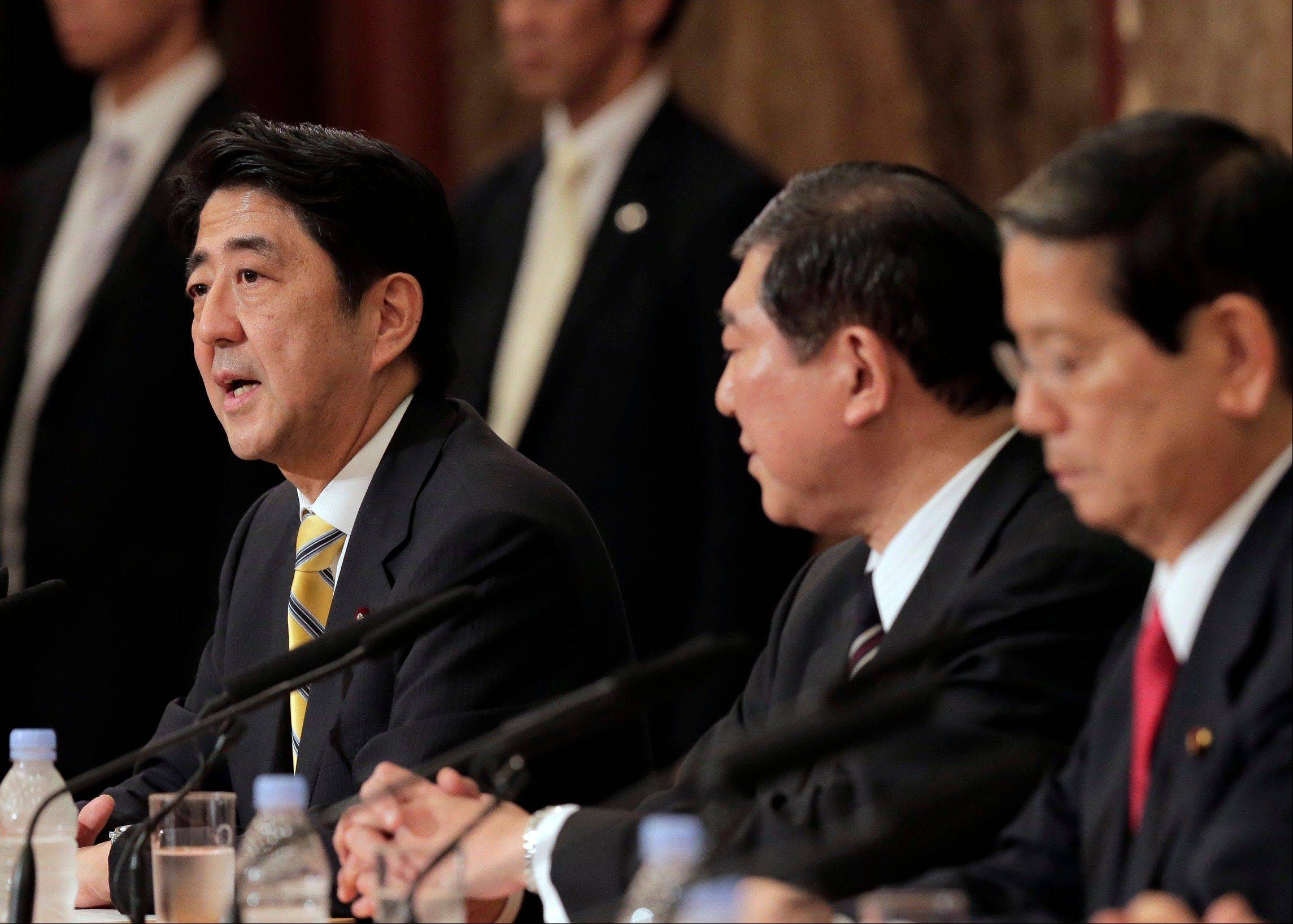 "Japan's leading opposition Liberal Democratic Party presidential candidate Shinzo Abe, left, as his rivals, Shigeru Ishiba, center, and Nobutaka Machimura, listen to him during a debate at the Japan National Press Club in Tokyo. Former Prime Minister Abe blasted China at a press conference Wednesday, Sept. 18, 2012, after anti-Japanese riots flared across China. He says that if Beijing can't protect Japanese living in China it ""should not enjoy membership in the international society."""