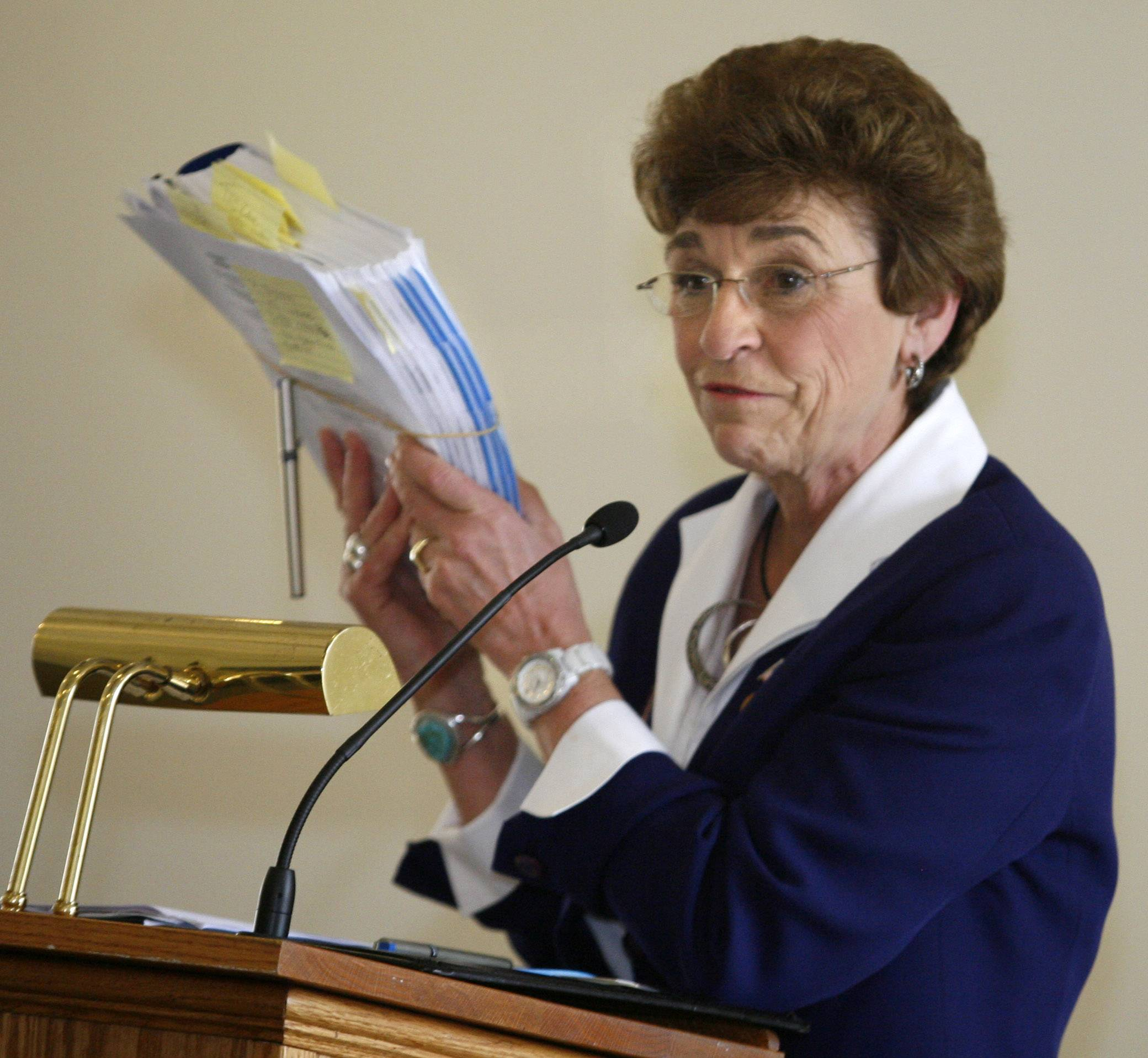 Arlington Heights Village President Arlene Mulder shows a copy of the village's budget for 2012 while delivering a state of the village address to residents at the Moorings in March. Mulder has announced she will not seek re-election when her term is up in 2013.