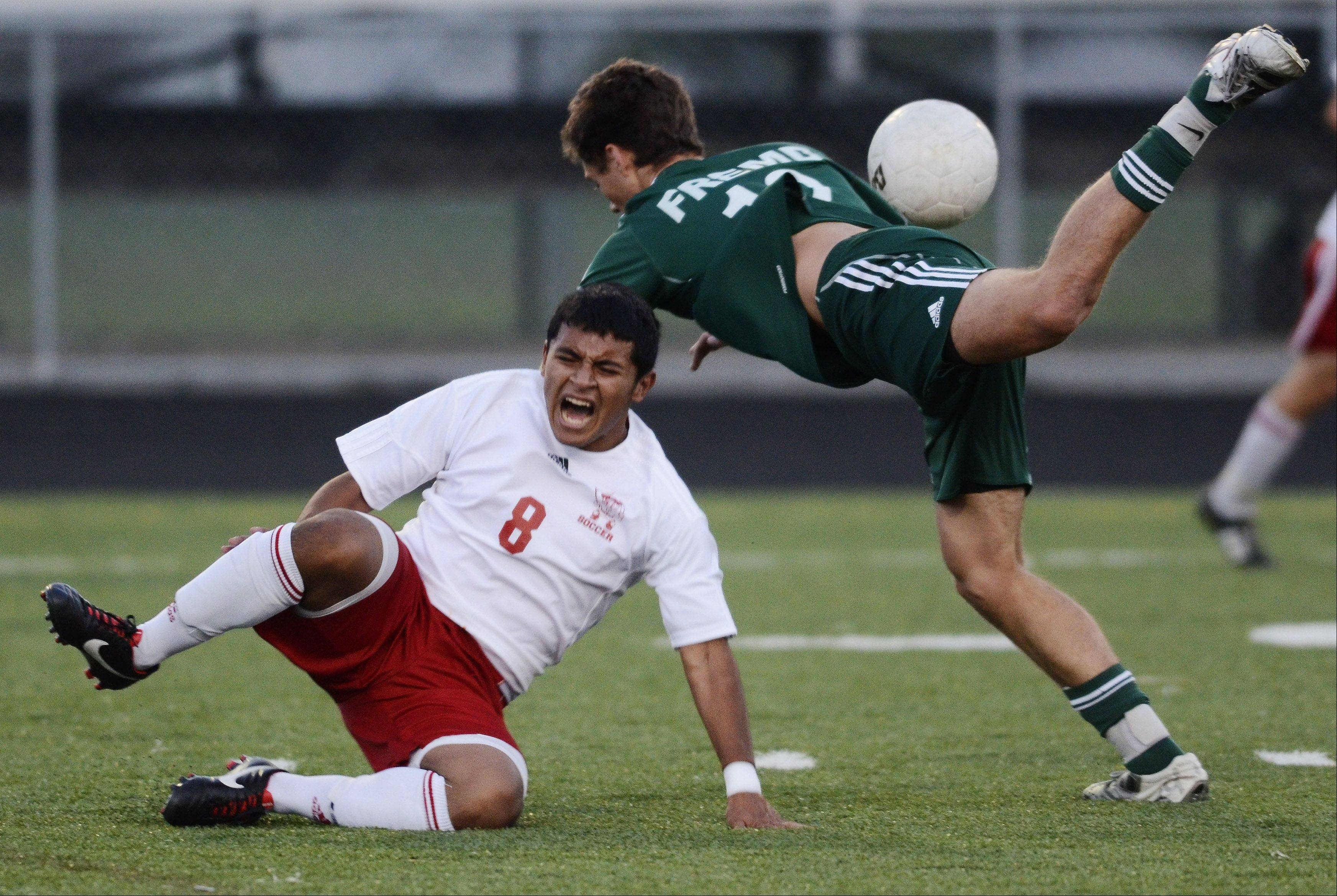 Palatine's Cesar Valdez, left, and Fremd's Michael Debellis make contact while in pursuit of the ball during Wednesday's game at Palatine.