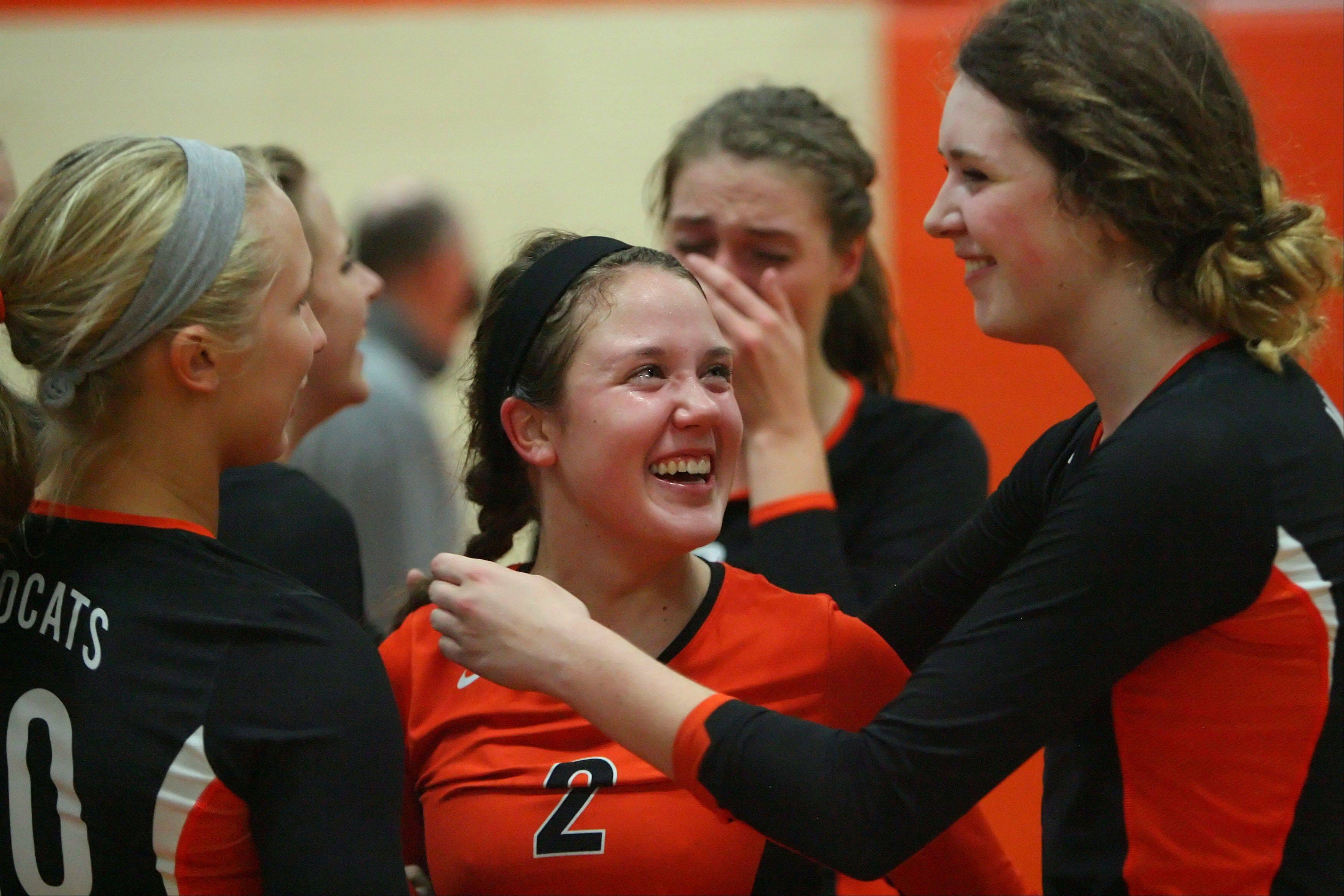 Libertyville's Dana Kym, left, and Alex Basler, right, celebrate their win over Stevenson with a teary-eyed Kristen Webb Wednesday night at Libertyville.