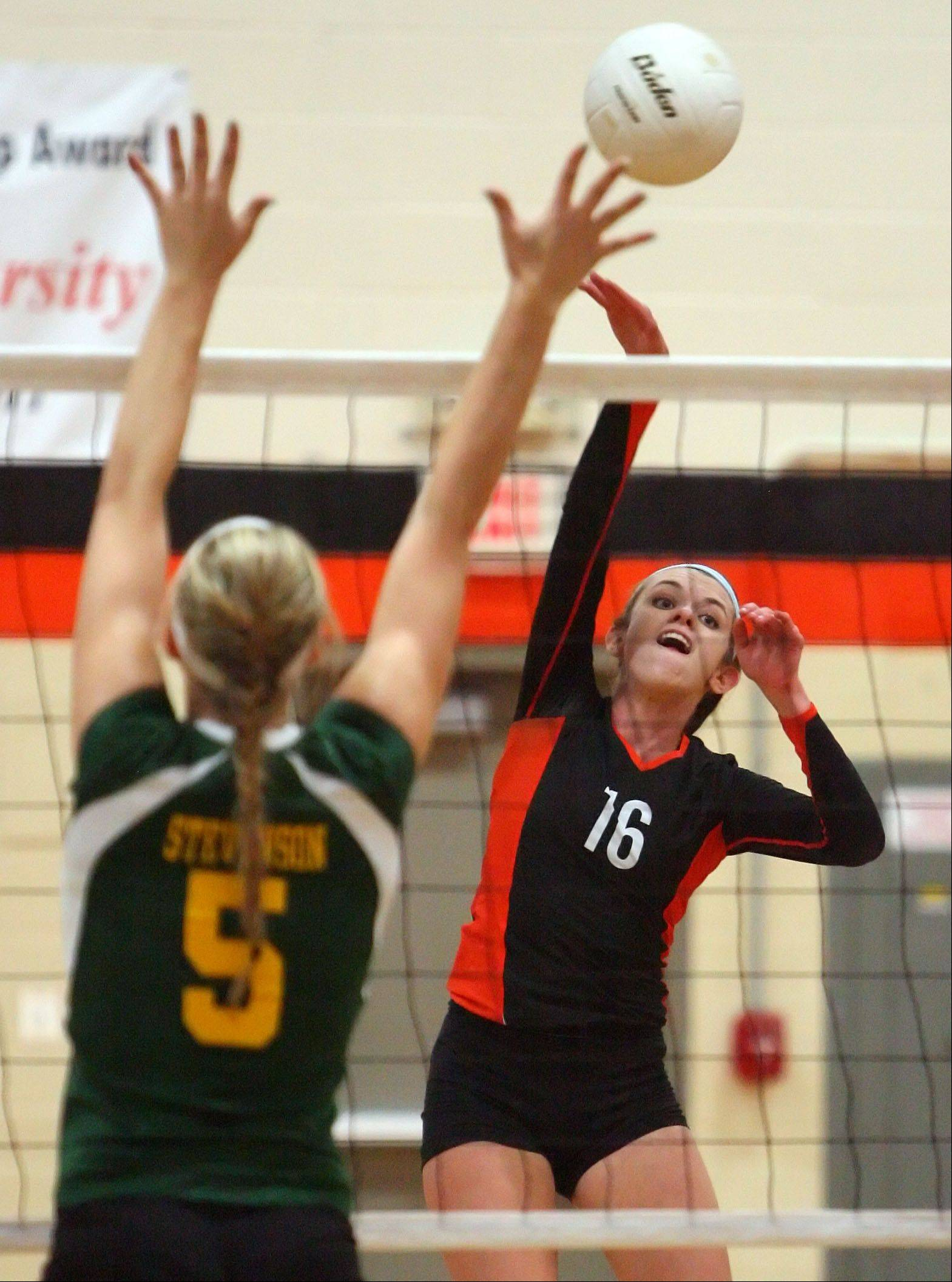 Libertyville's Rhiannon Prentiss, right, spikes one toward Stevenson's Jenna Radtke during the Wildcats' 3-set win Wednesday night at Libertyville High School.