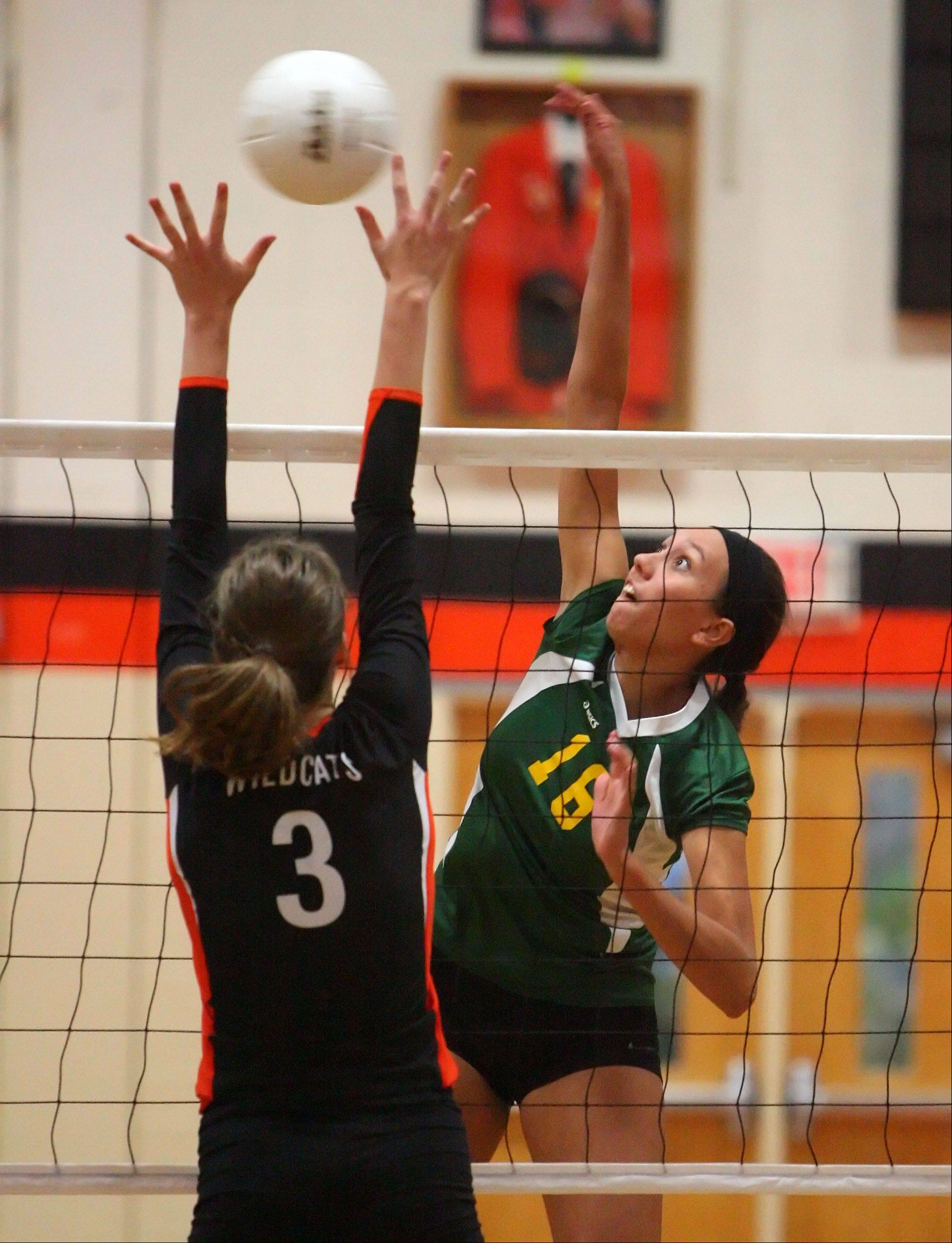 Stevenson's Liza Pflugradt, right, spikes one at Libertyville's Taylor Zant during their game Wednesday night at Libertyville.