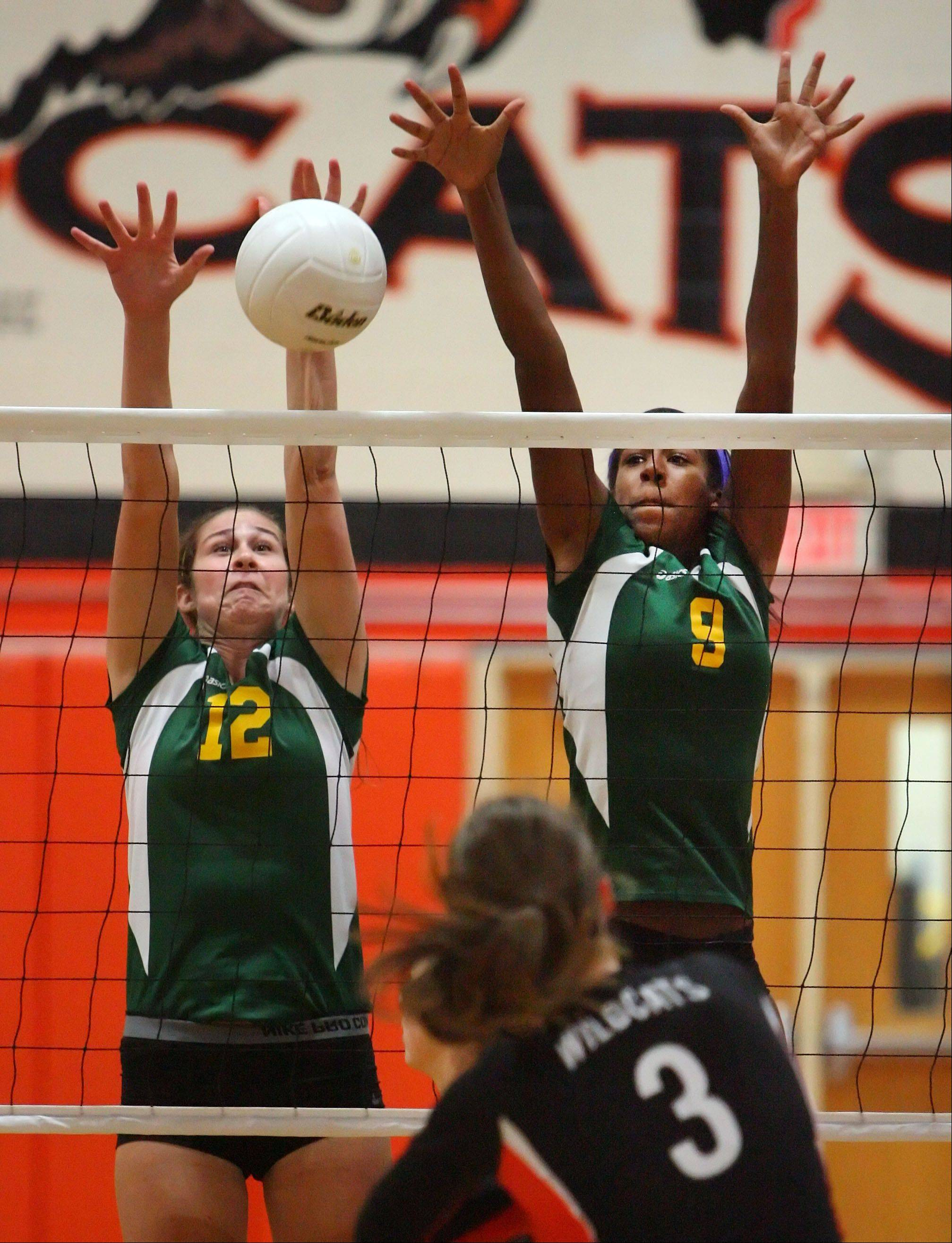 Stevenson's Julia Osmond, left, and Khaila Donaldson block the attack by Libertyville's Taylor Zant Wednesday night at Libertyville.