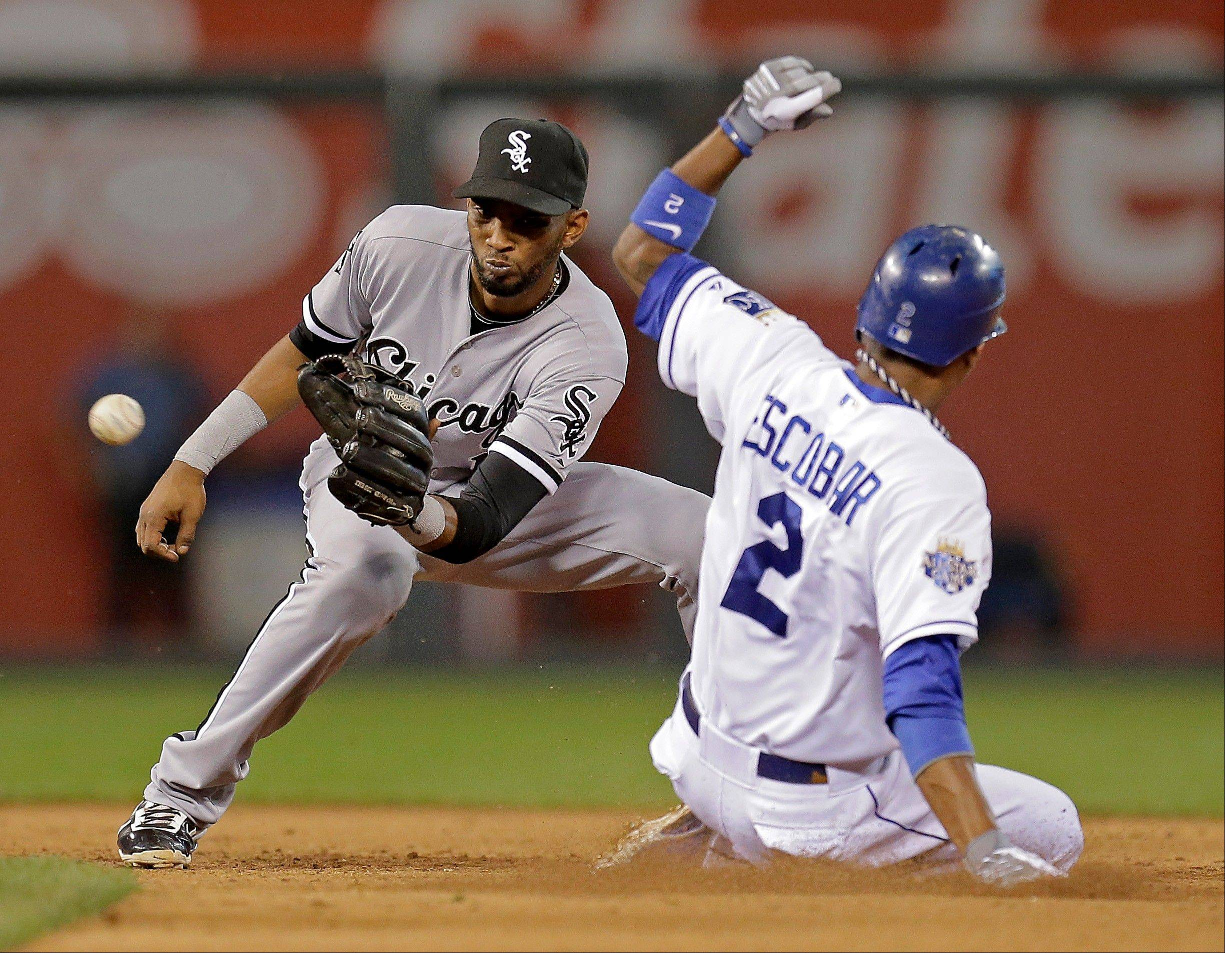 The Kansas City Royals' Alcides Escobar beats the tag by White Sox shortstop Alexei Ramirez to steal second base Wednesday during the fifth inning in Kansas City, Mo.