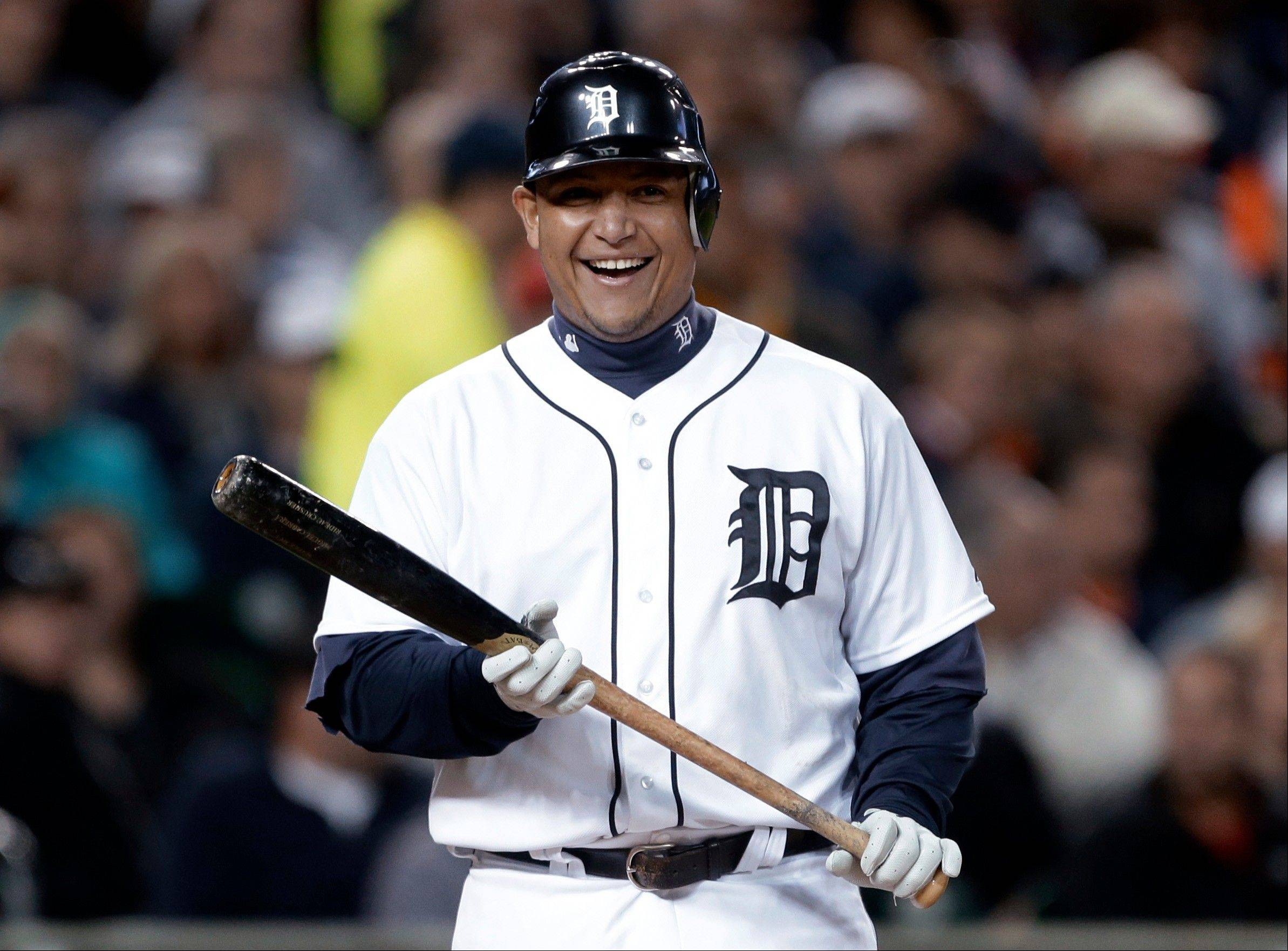 The Detroit Tigers' Miguel Cabrera smiles Wednesday while being intentionally walked by the Oakland Athletics during the third inning.