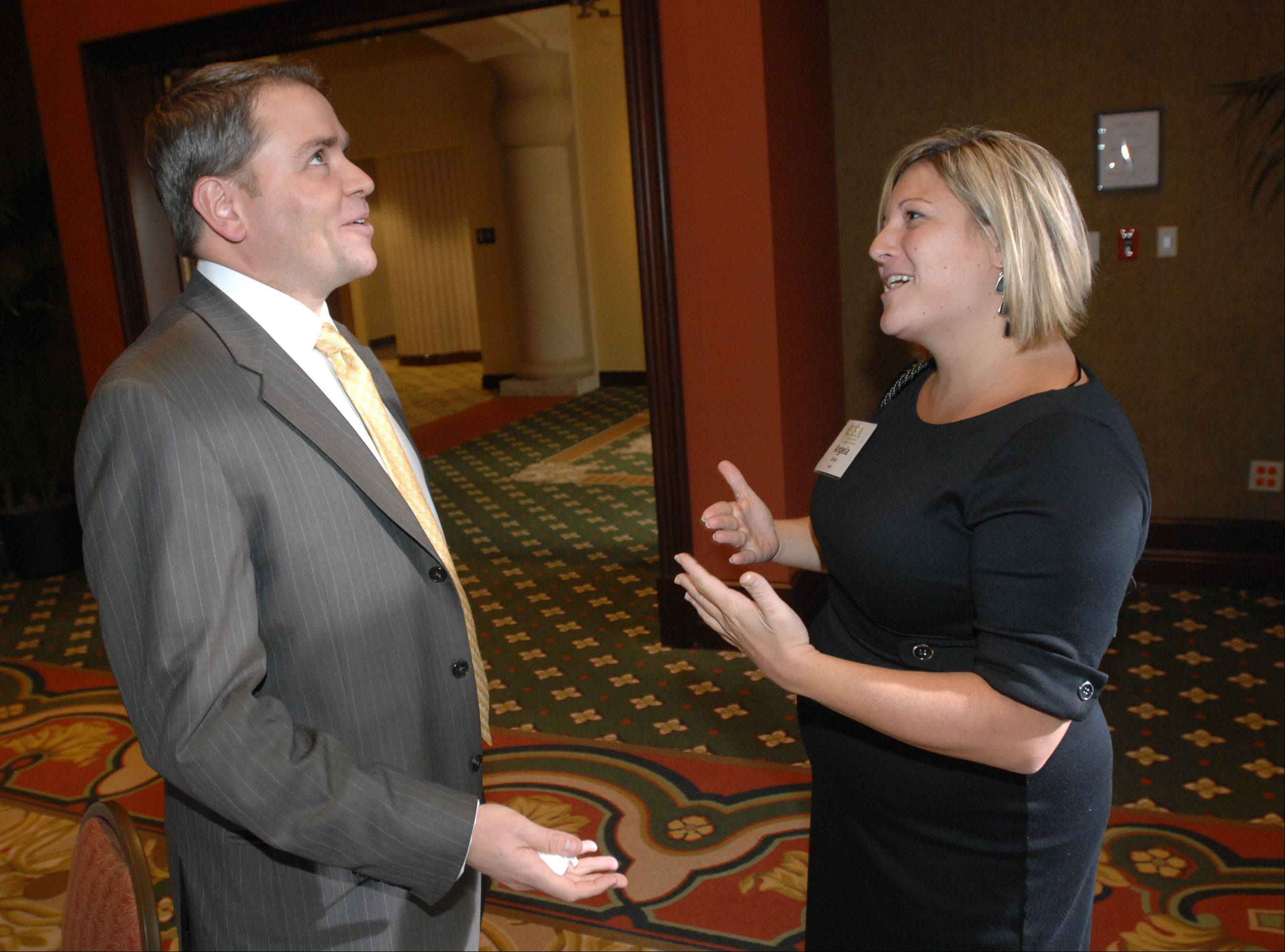 Patrick Hurley,left, and Angie Aliota, both of the DuPage County Bar Association, chat during the 13th Annual Entrepreneurial Excellence Awards at Medinah Banquets in Addison Thursday.