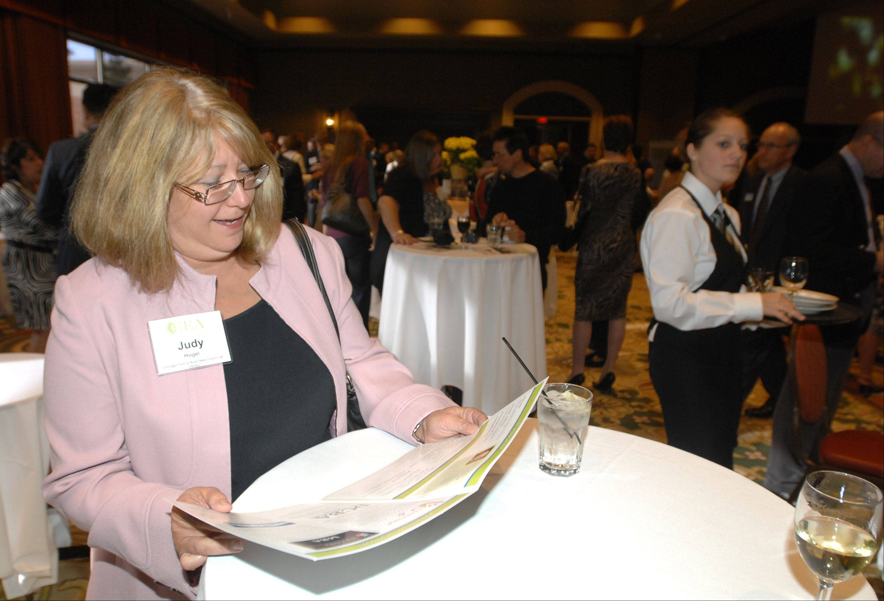 Judy Hogel looks over the program at the 13th Annual Entrepreneurial Excellence Awards at Medinah Banquets in Addison Thursday.