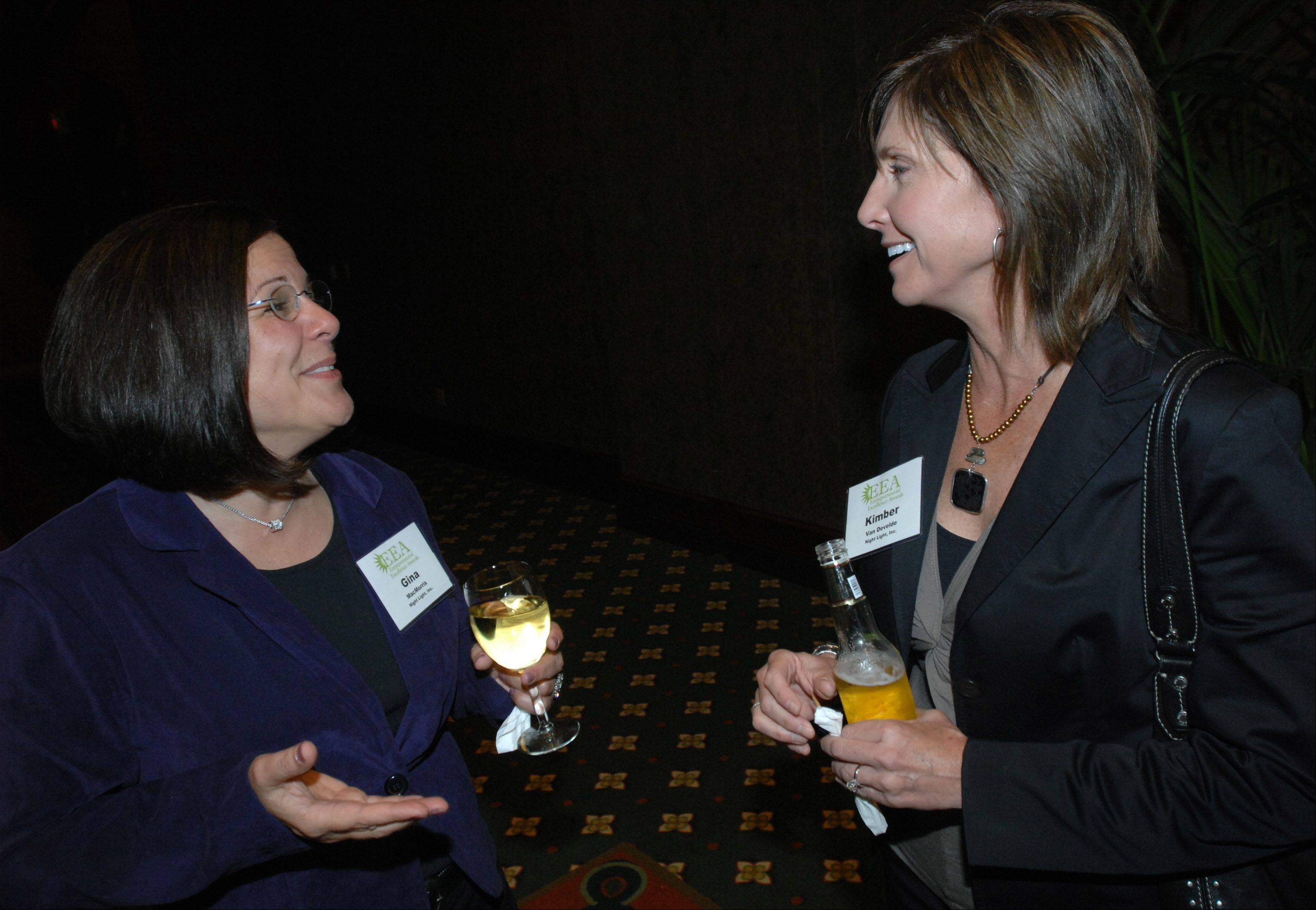 Gina MacMorris,left, and Kimber VanDevelde, both of Night Light,Inc, chat during the 13th Annual Entrepreneurial Excellence Awards at Medinah Banquets in Addison Thursday.