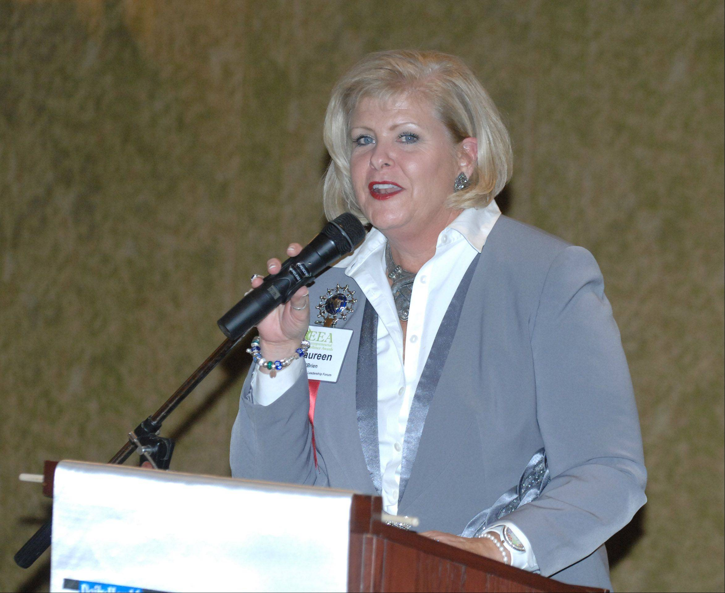 Maureen O'Brien of Global Women's Leadership Forum, Batavia gives thaks for being honored with the Early Satge award during the 13th Annual Entrepreneurial Excellence Awards at Medinah Banquets in Addison Thursday.