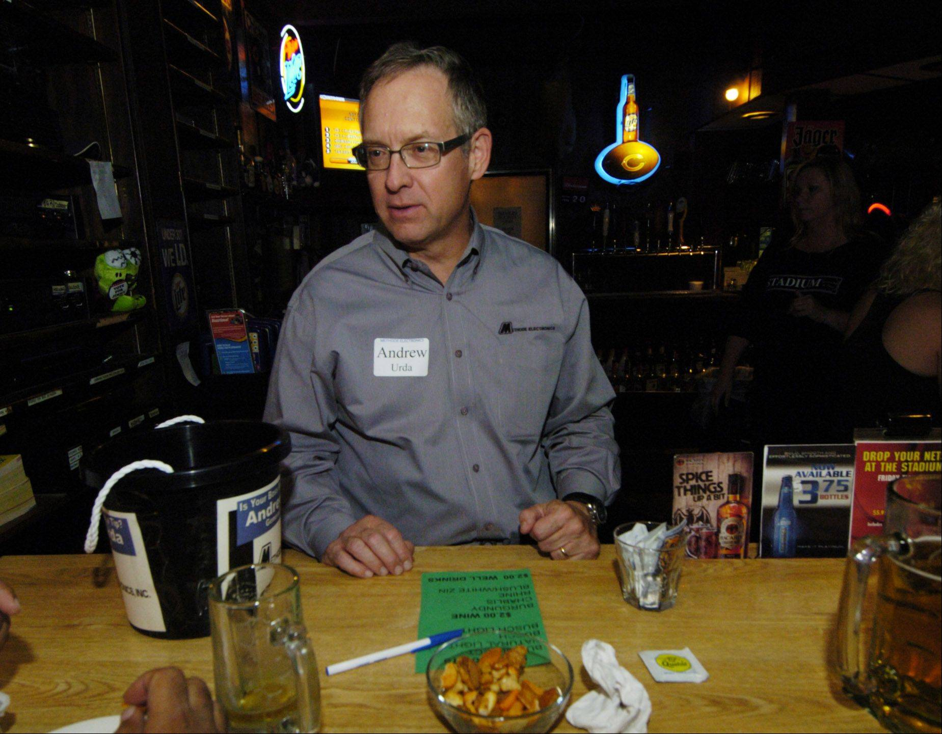 Andrew Urda, general manager of Methode Electronics, competes as a celebrity bartender Thursday at Stadium Sports Club during a Rolling Meadows Chamber of Commerce fundraiser.