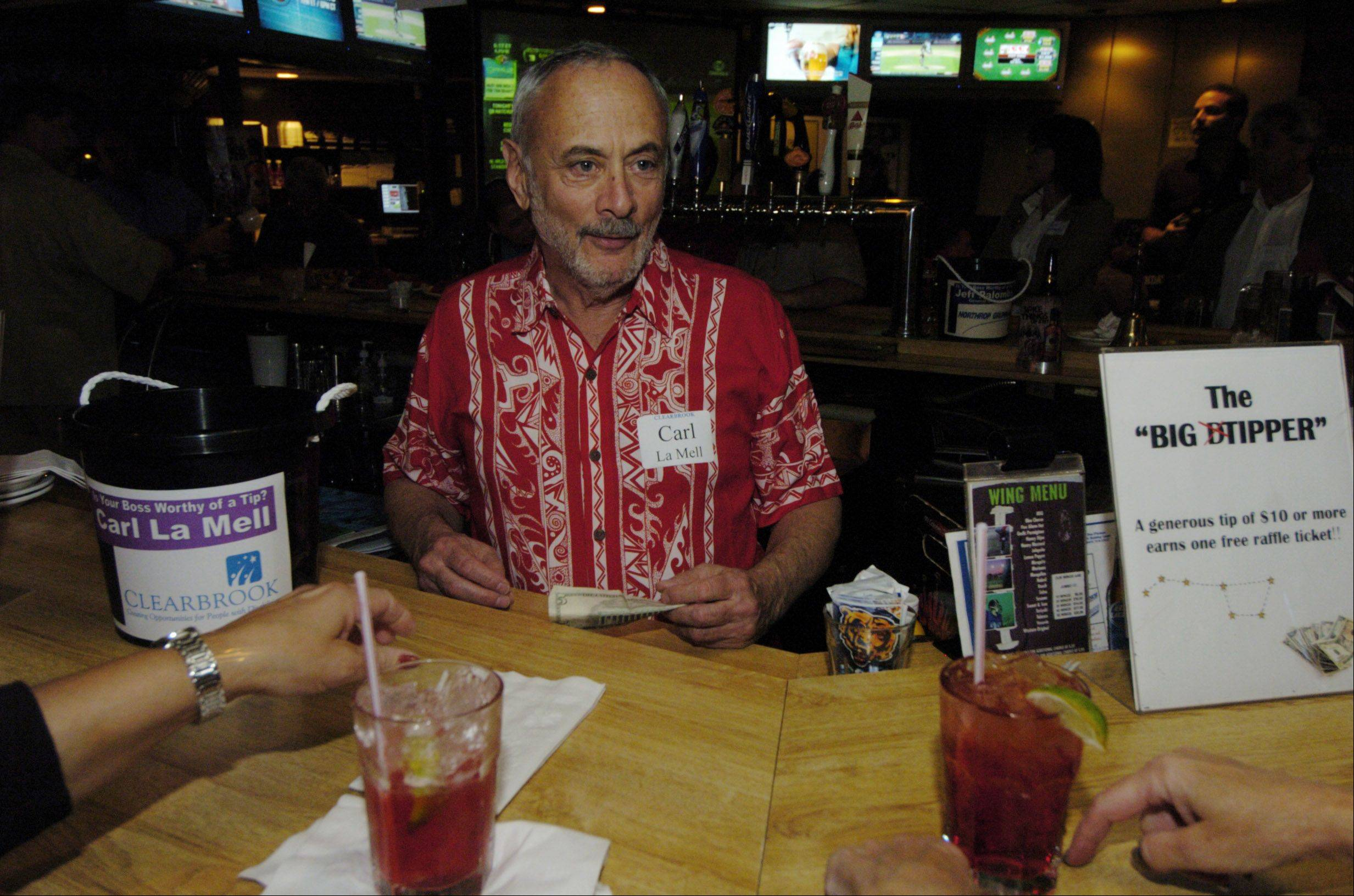 Carl LaMell, president of Clearbrook, competes as a celebrity bartender Thursday in a Rolling Meadows Chamber of Commerce event at Stadium Sports Club.