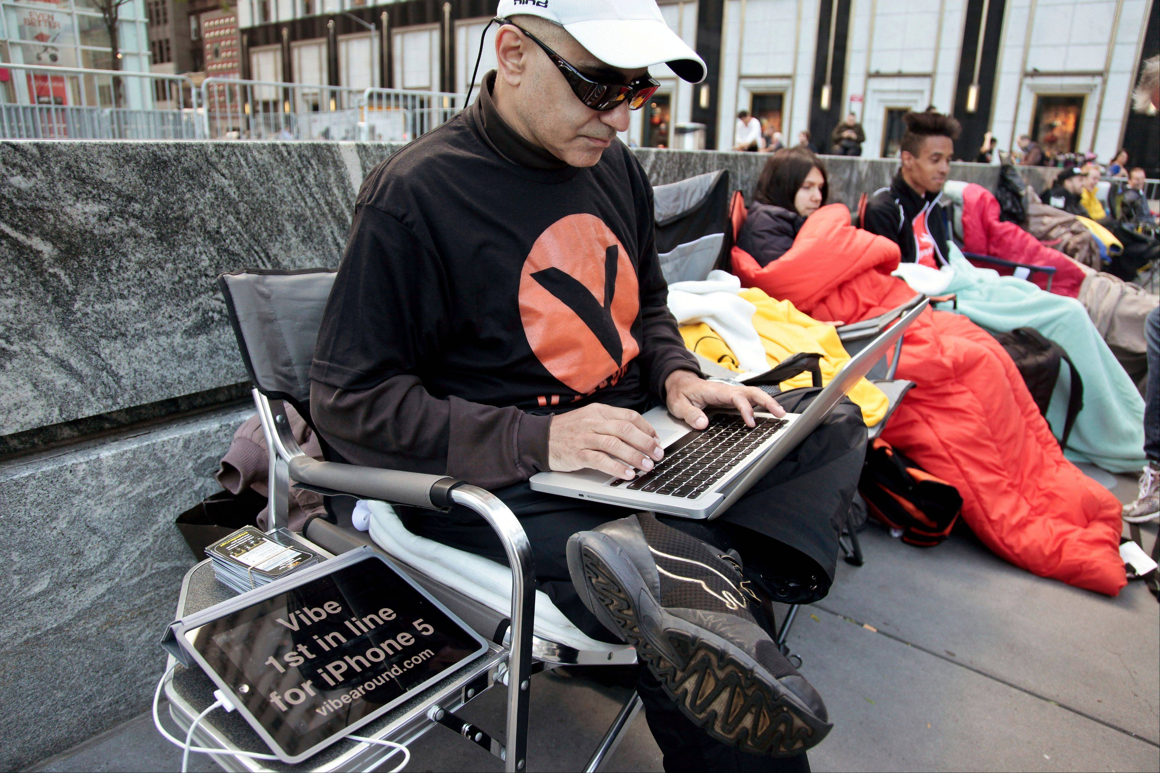 Hazen Sayer, an app developer, is first in line outside Apple's Fifth Avenue store on Thursday in New York. Sayer started camping out a week ago to be one of the first to get the new iPhone 5, which will go on sale in the U.S. and eight other countries Friday.