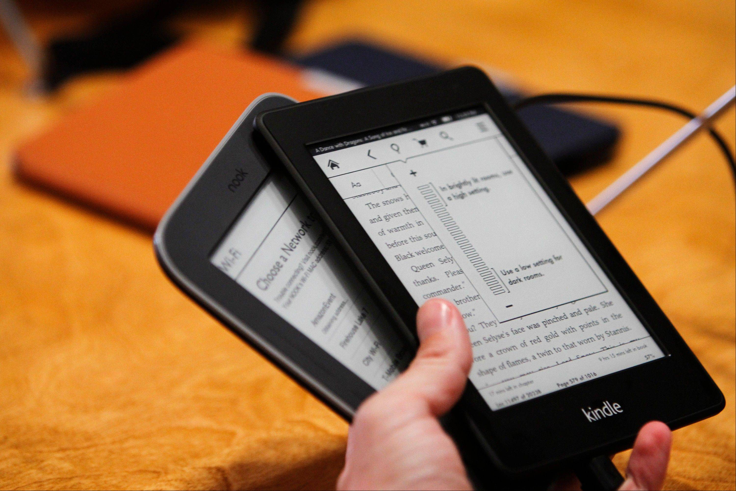 Wal-Mart will no longer sell the Amazon.com Kindle, seen at right, the chain announced Thursday.