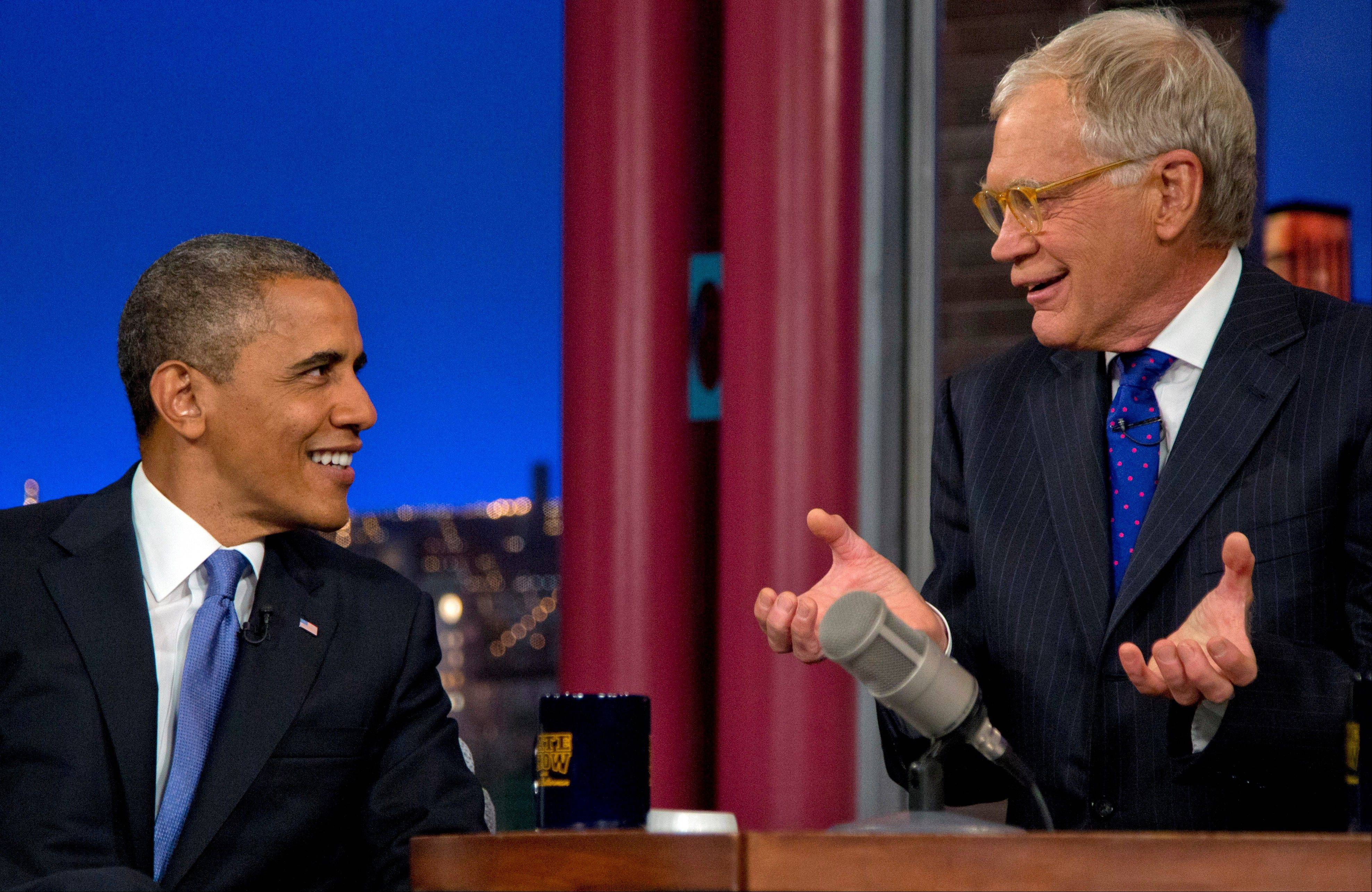 "President Barack Obama talks with David Letterman on the set of the ""Late Show With David Letterman"" Tuesday in New York."