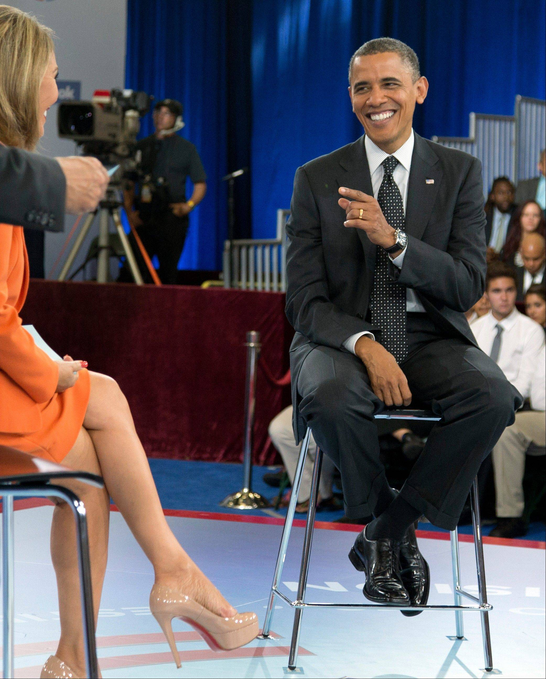 President Barack Obama participates in a town hall hosted by Univision and Univision news anchor Maria Elena Salinas, left, at the University of Miami Thursday in Coral Gables, Fla.