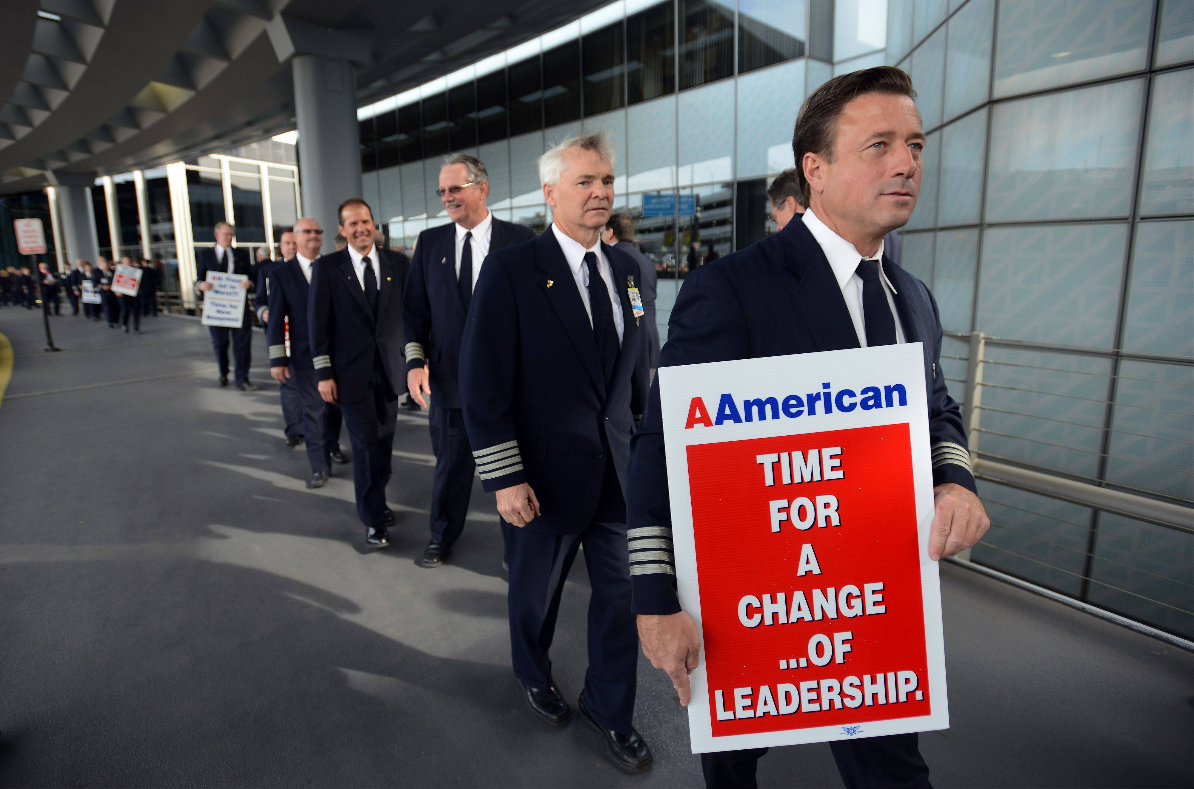 American Airlines pilot Jeff Paschen of Kildeer, who has been on the job for 23 years, walks the picket line at O'Hare International Airport protesting working conditions and poor management practices on Thursday.