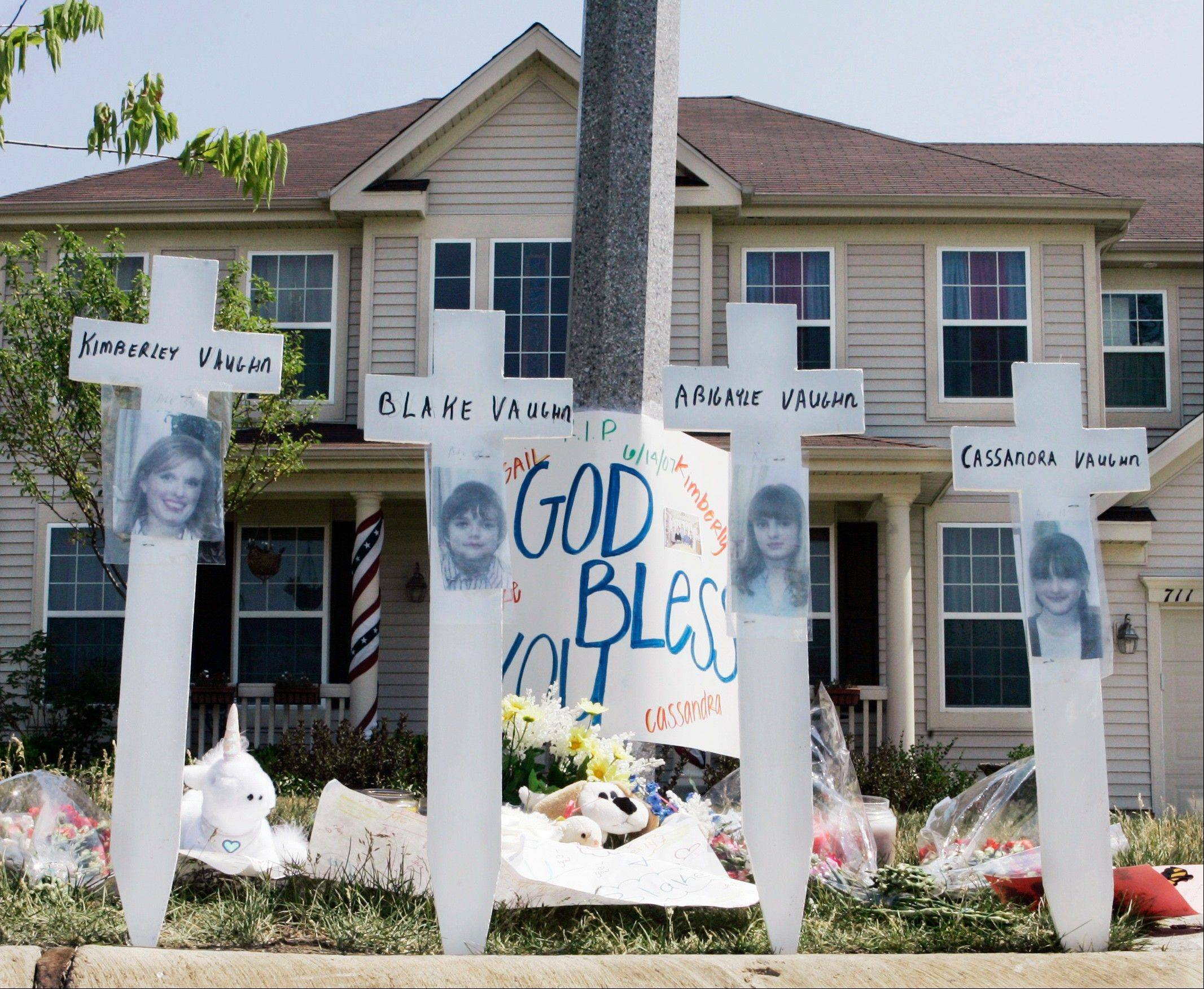 A makeshift memorial to Kimberly Vaughn and her three children, Abigayle, 12, Cassandra, 11, and Blake, 8, was erected outside their home in Oswego in 2007.