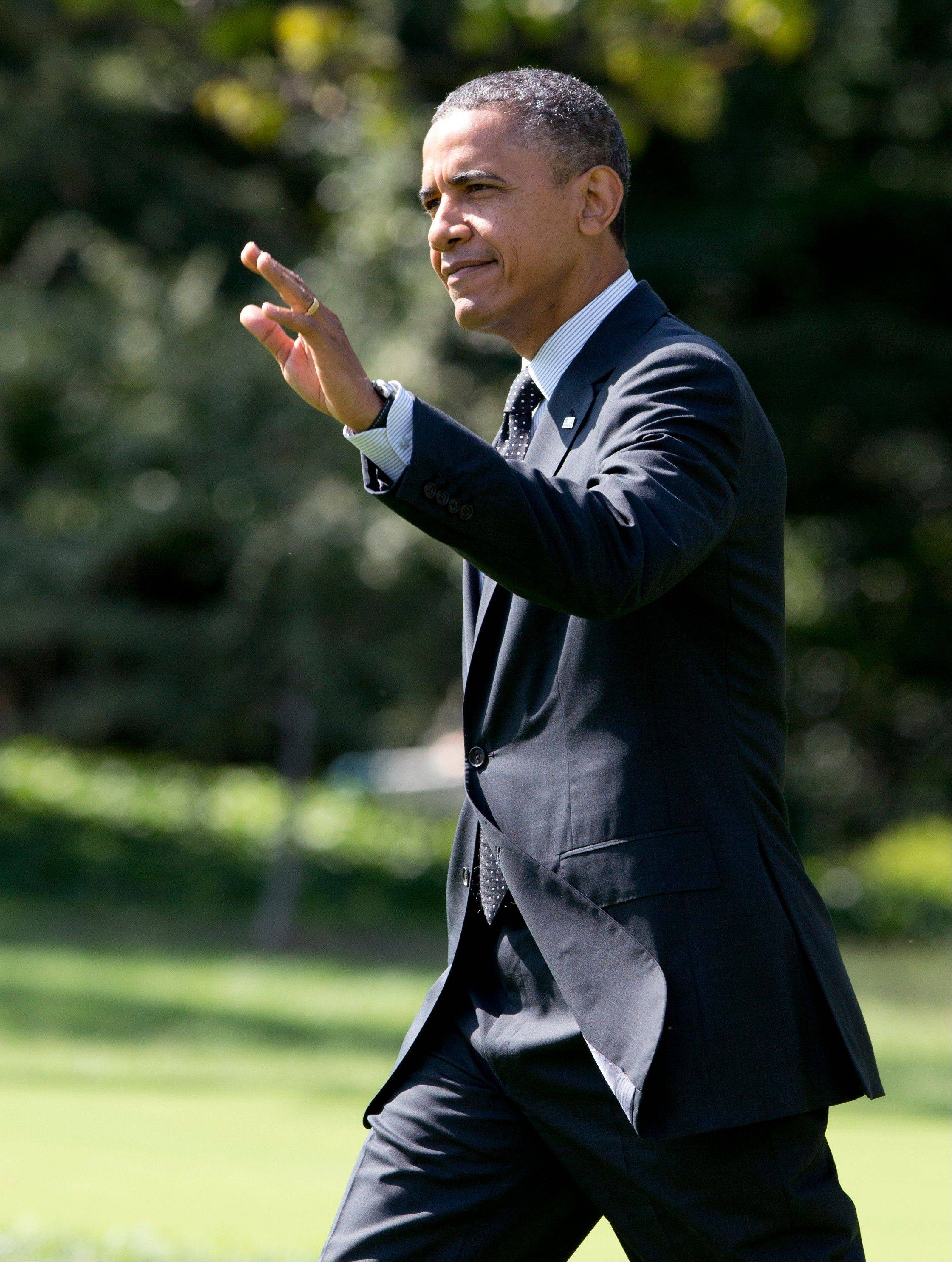President Barack Obama waves as he leaves the White House on Thursday for a campaign trip to Florida.