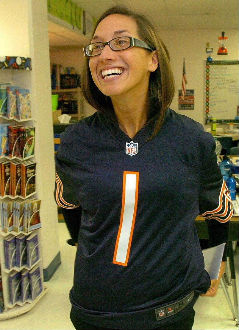 Grove Avenue School teacher Michelle Jackson sports her Bears jersey, after receiving surprise recognition by Gallagher Benefit Services and the Chicago Bears through the Symetra Heroes in the Classroom program.