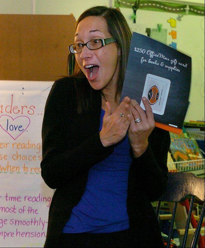 Grove Avenue School teacher Michelle Jackson reacts to receiving surprise recognition by Gallagher Benefit Services and the Chicago Bears through the Symetra Heroes in the Classroom program.