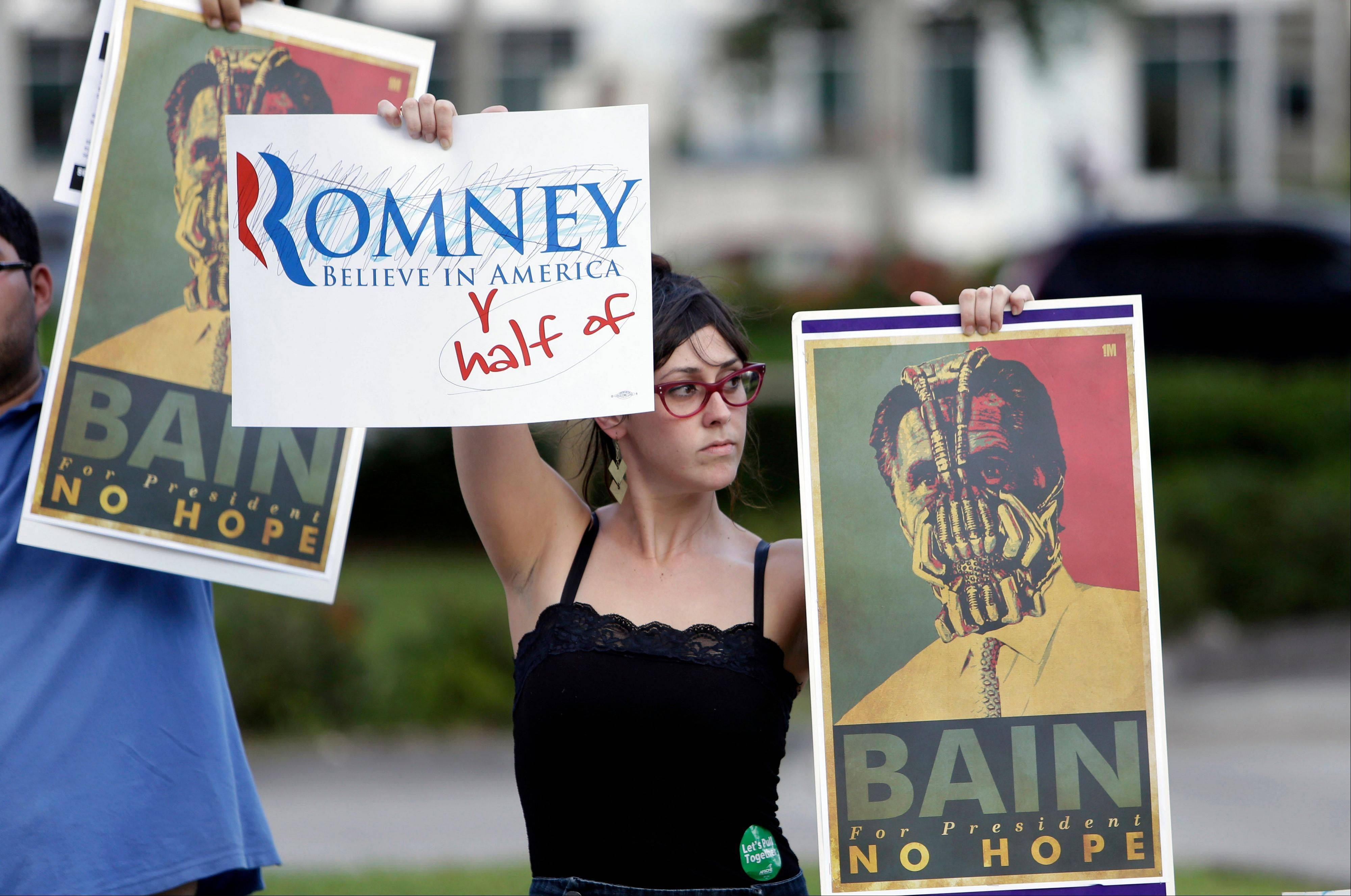 Rebecca Fernandez of Miami protests outside of the University of Miami where Republican presidential candidate Mitt Romney was attending a Meet the Candidates forum held by Univision, Wednesday, Sept. 19, 2012, in Coral Gables, Fla.