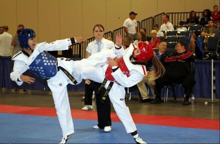 Fabiola Carrillo, 15, of Villa Park spars in a taekwondo match Sept. 8 in Fort Lauderdale, Fla. Her victory was one of several in the team trials event, helping to secure her spot on the AAU Junior National Team.