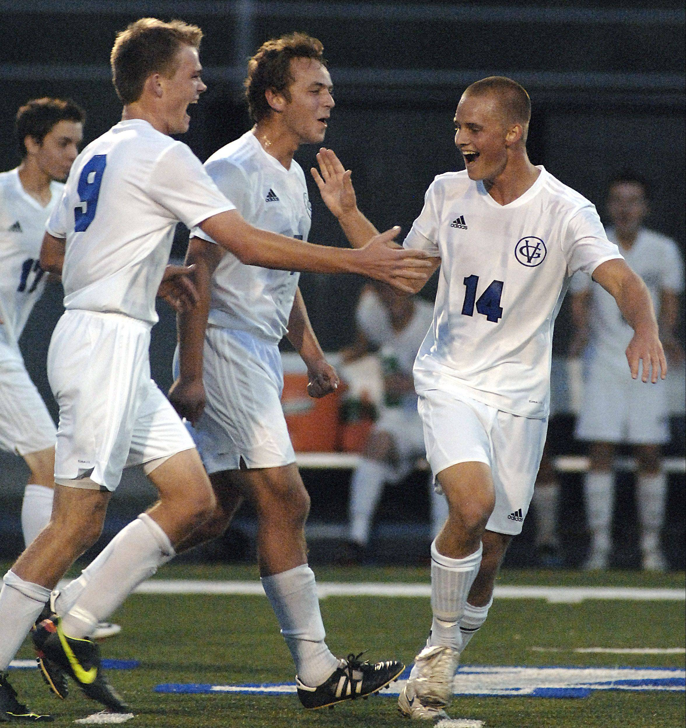 Geneva's Nick Konicek (14) gets congratulations from teammates Matt Butz and Joshua Poythress Thursday.