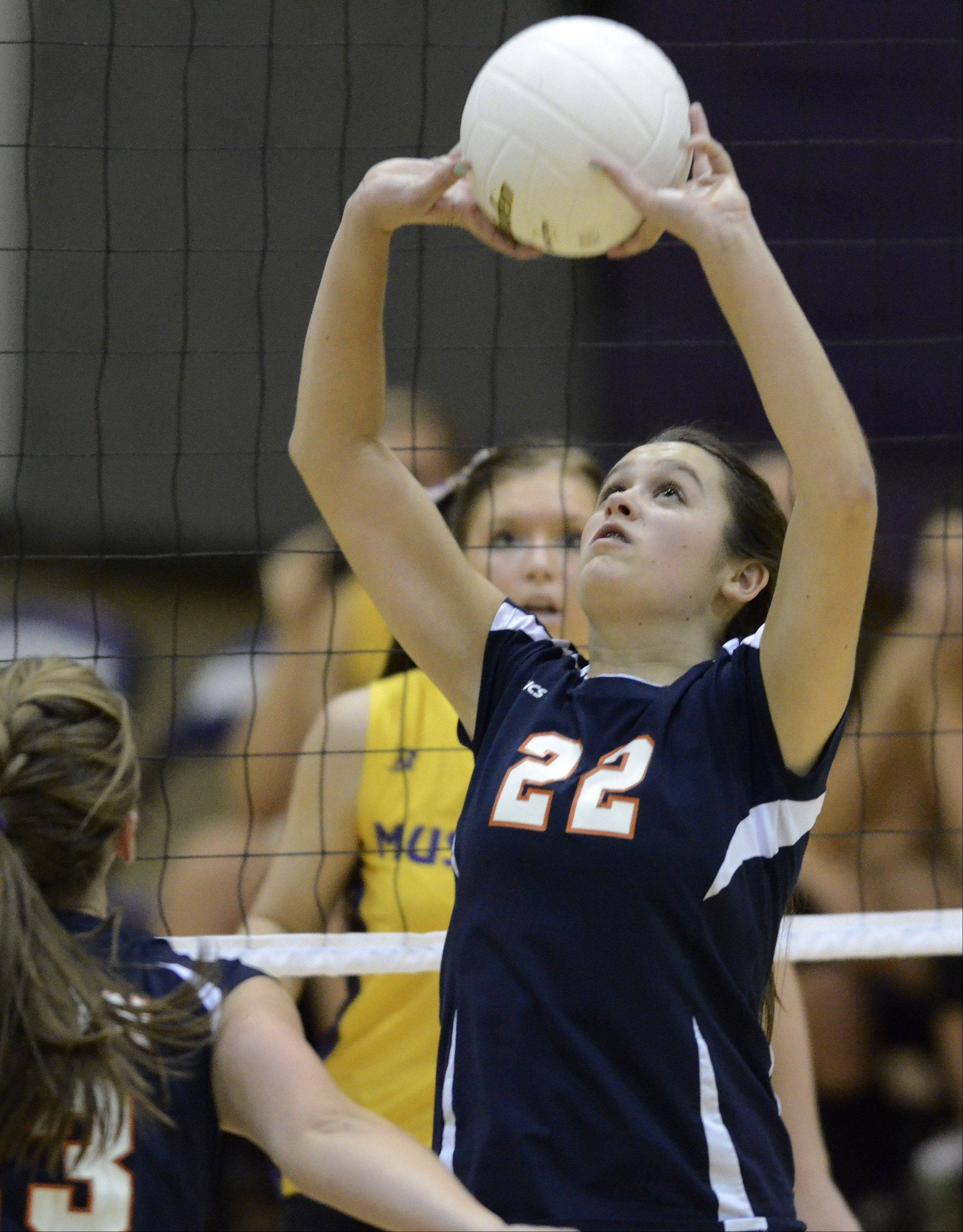 Buffalo Grove's Marie Georgoulis sets the ball during Thursday's game against Rolling Meadows. Her 8-point service streak was key to the Mustangs' victory.