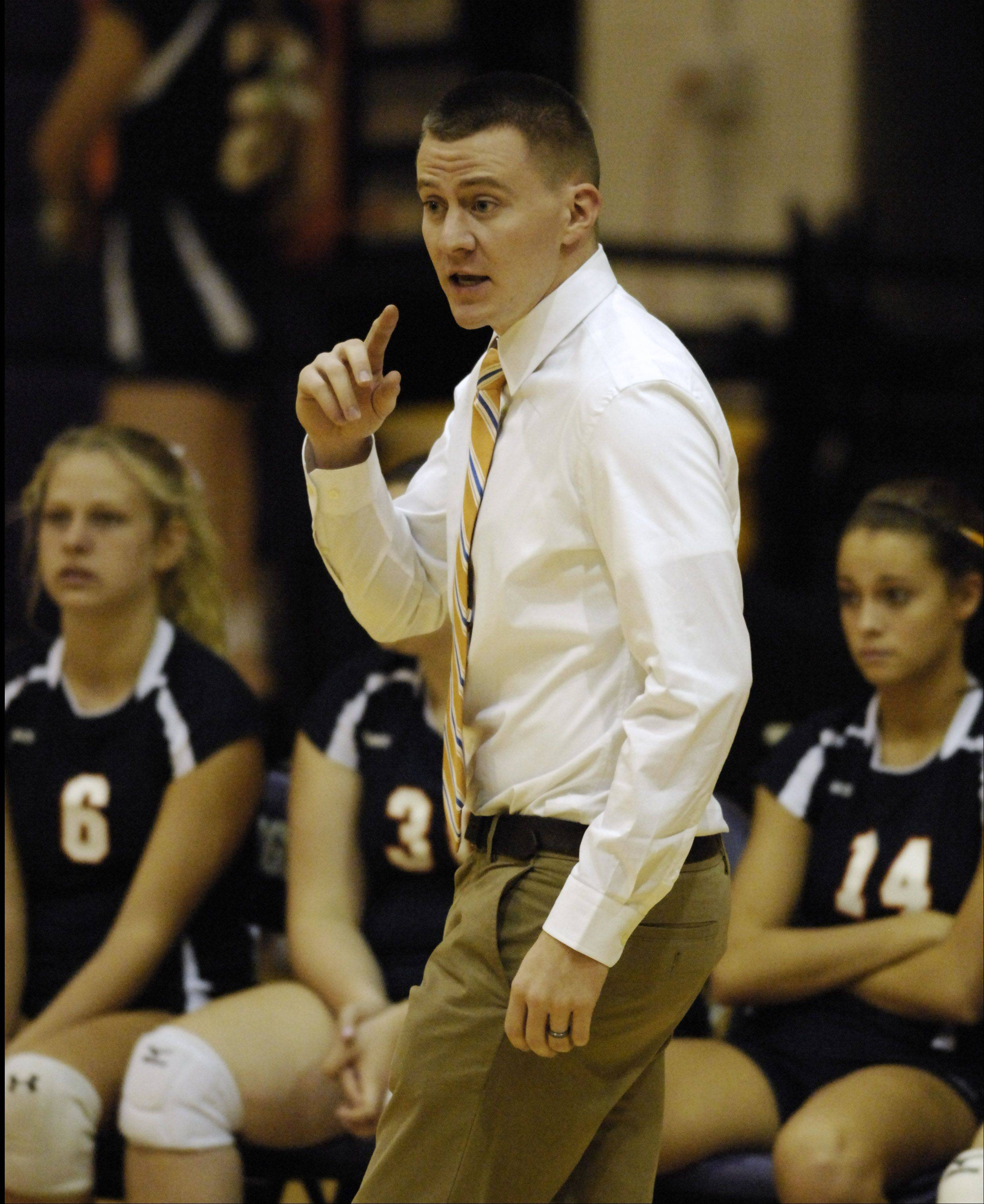 Buffalo Grove girls volleyball coach Matt Priban leads his team during Thursday's game against Rolling Meadows.