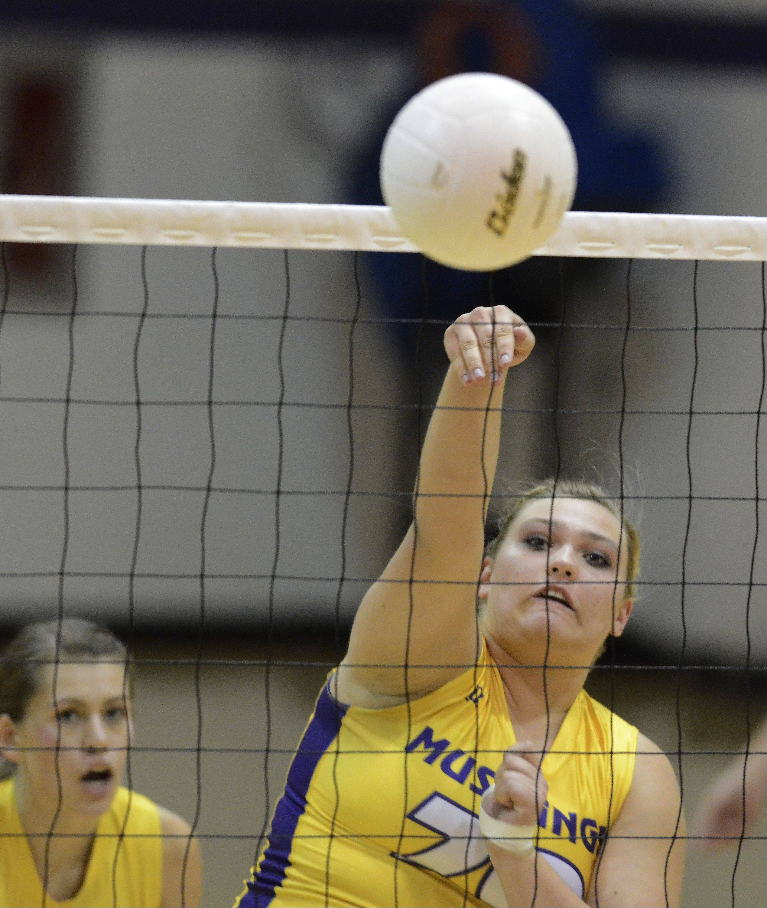 Rolling Meadows' Morgan Keller returns a volley during Thursday's game against Buffalo Grove.