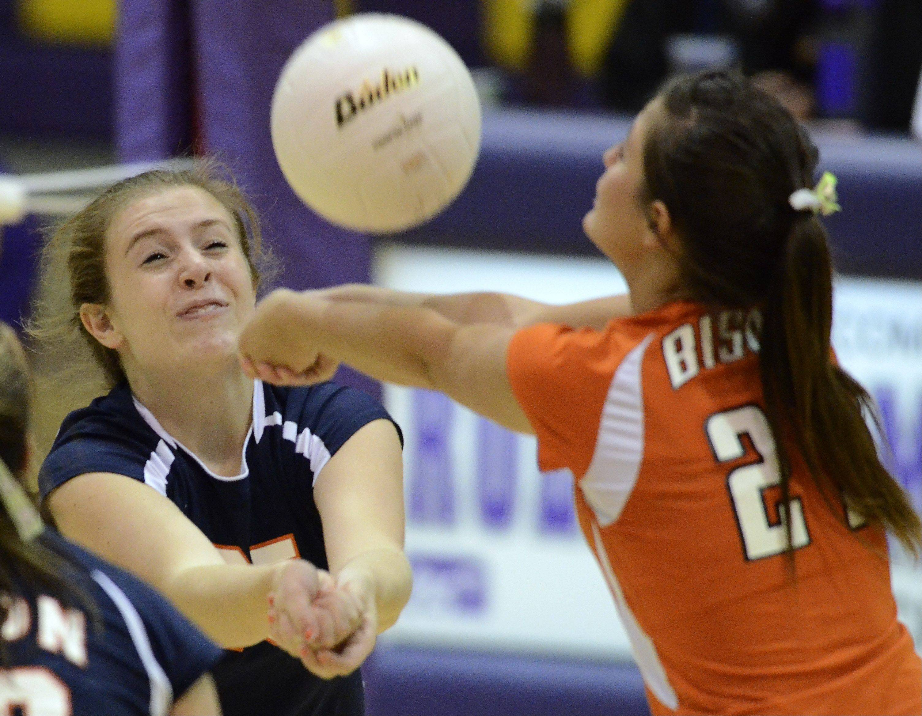Buffalo Grove's Alyssa Mills, left, and Lea Masciopinto converge upon one another as they run for a dig during Thursday's game against Rolling Meadows.