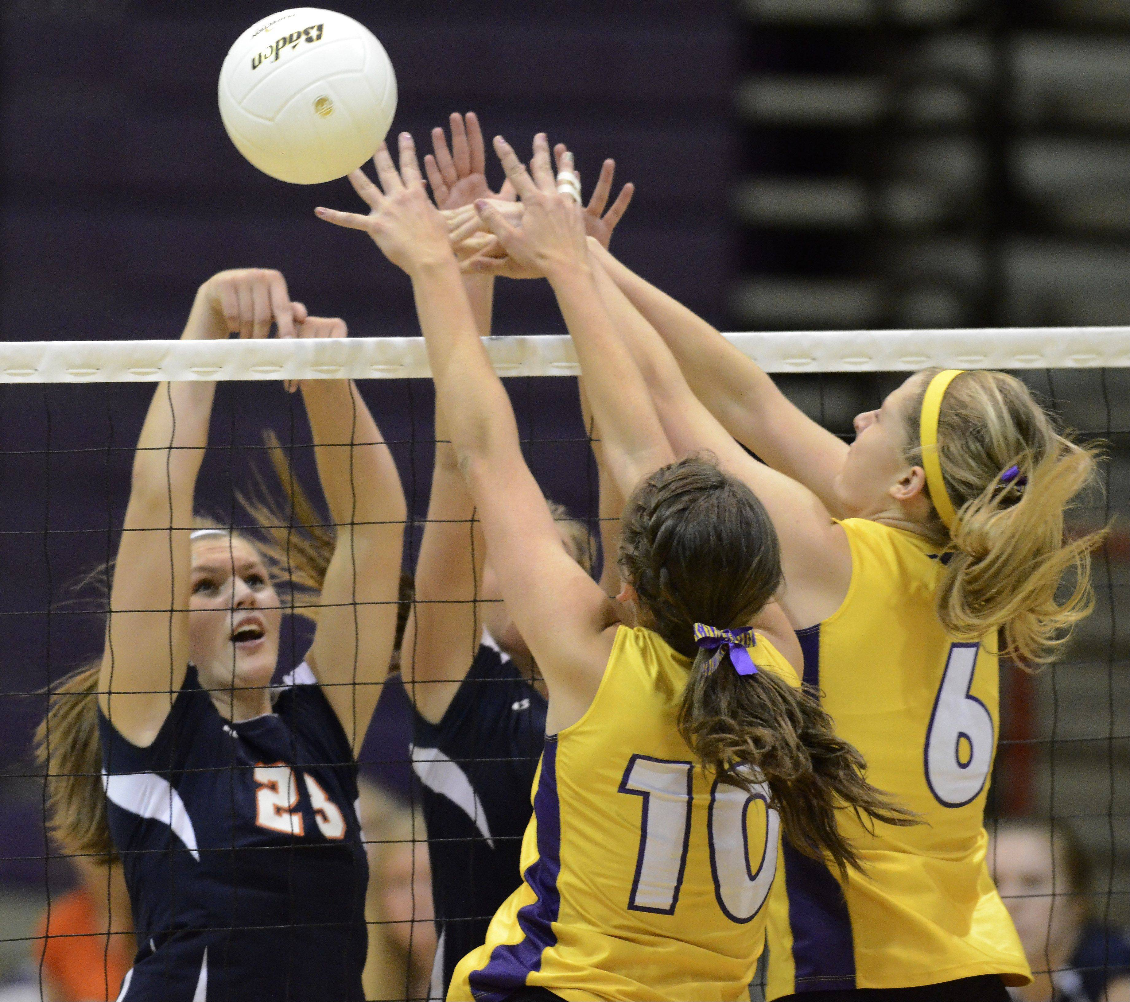 Buffalo Grove's Alyssa Mills, left, and Rolling Meadows' Rachel Mickey and Jenny Vliet, right, converge at the net during Thursday's game.