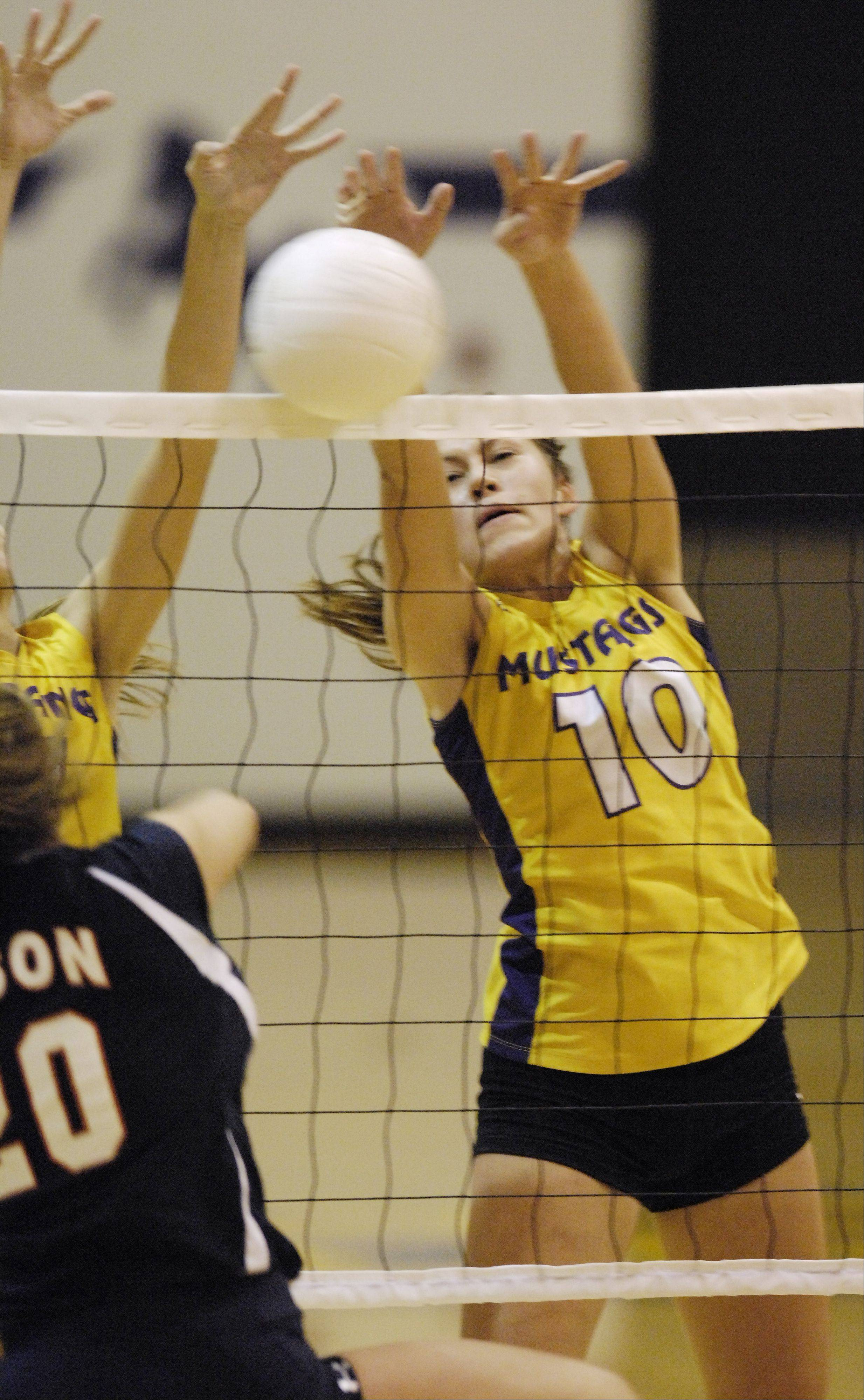 Rolling Meadows' Rachel Mickey, right, blocks a ball at the net on a kill attempt by Buffalo Grove's Alaina Murphy.
