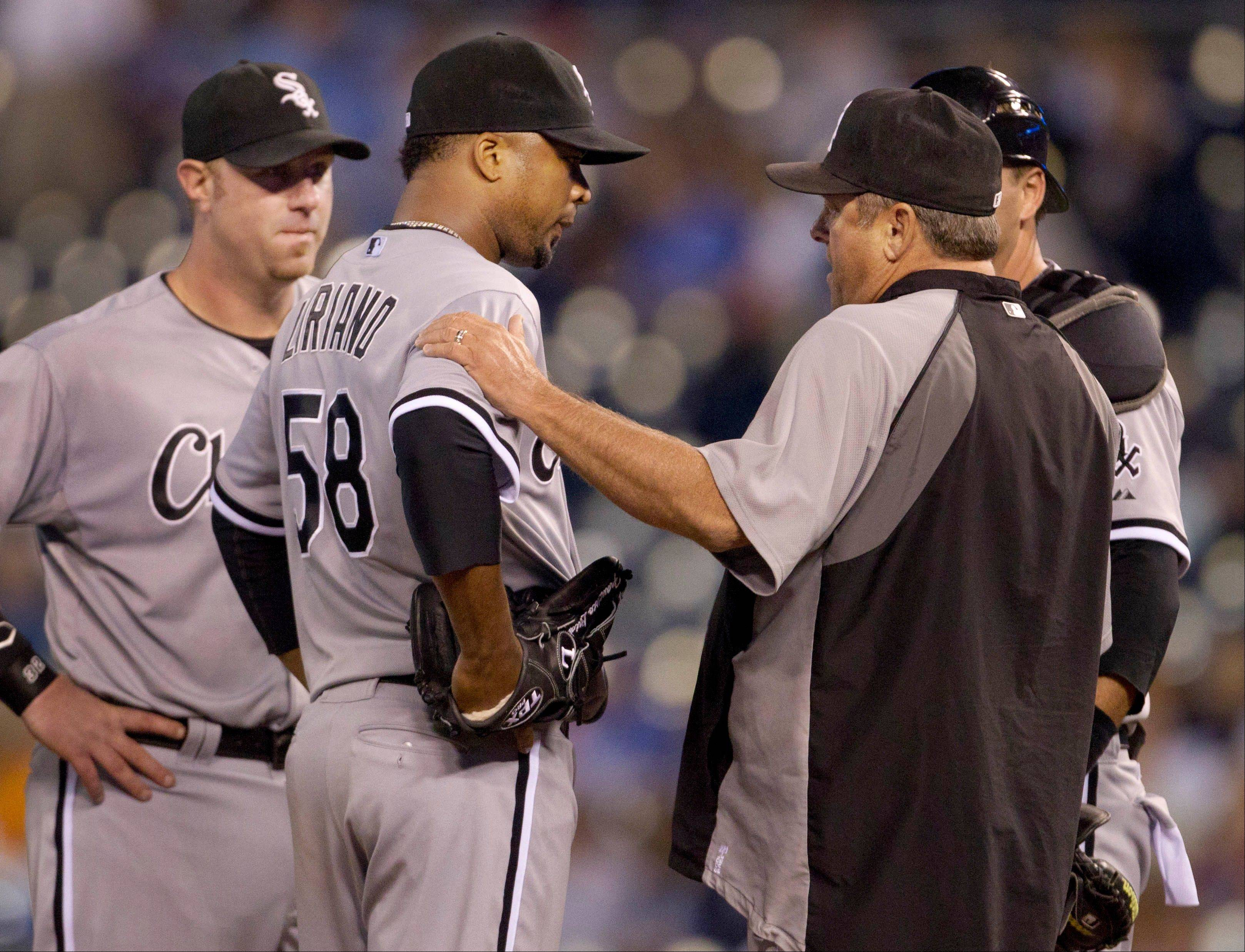 White Sox pitching coach Don Cooper, right, talks with starting pitcher Francisco Liriano (58) Thursday during the fifth inning at Kauffman Stadium in Kansas City, Mo.
