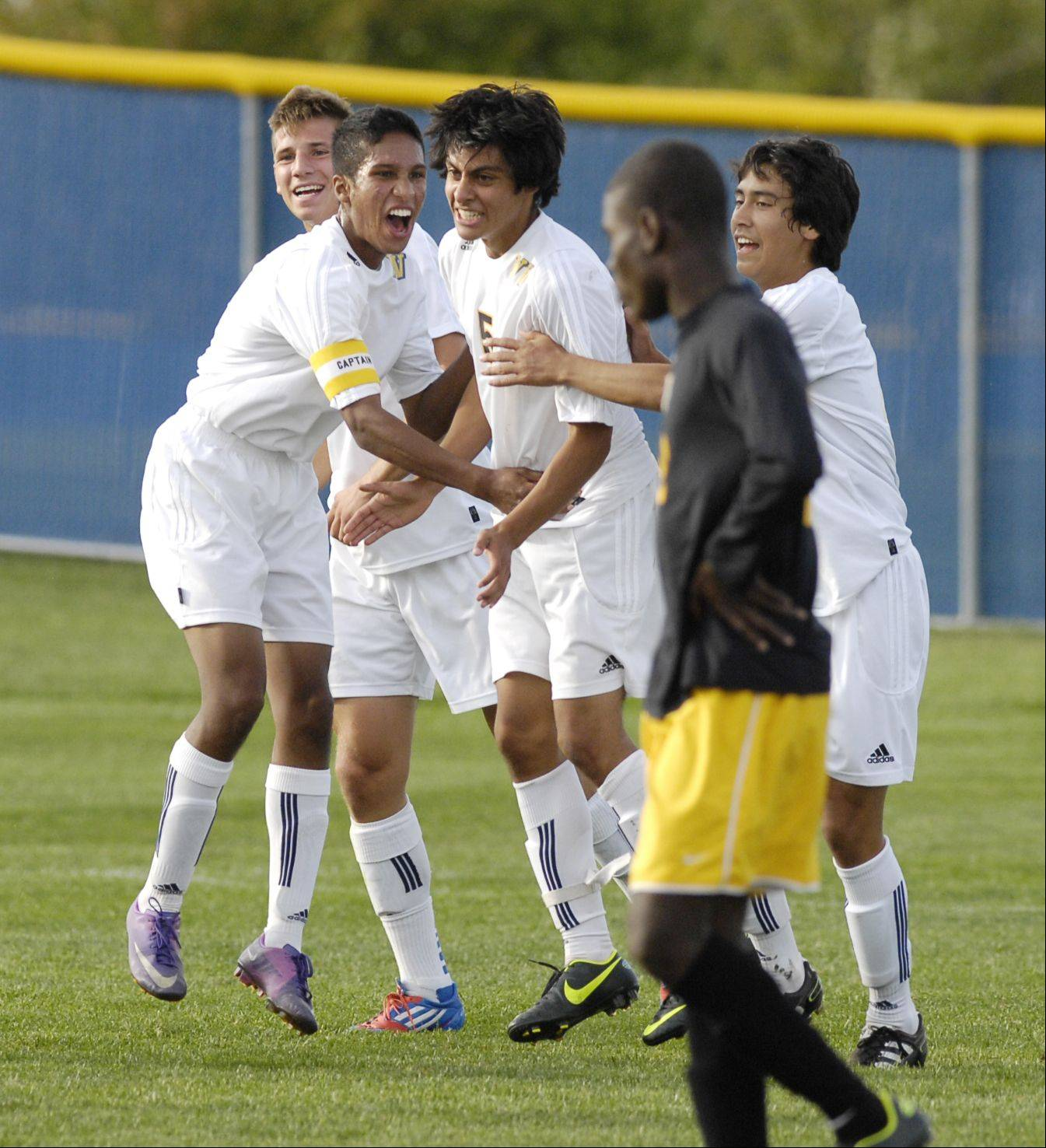 Neuqua Valley celebrates a goal by Eduardo Cruz (5) during boys soccer against Metea Valley at home.