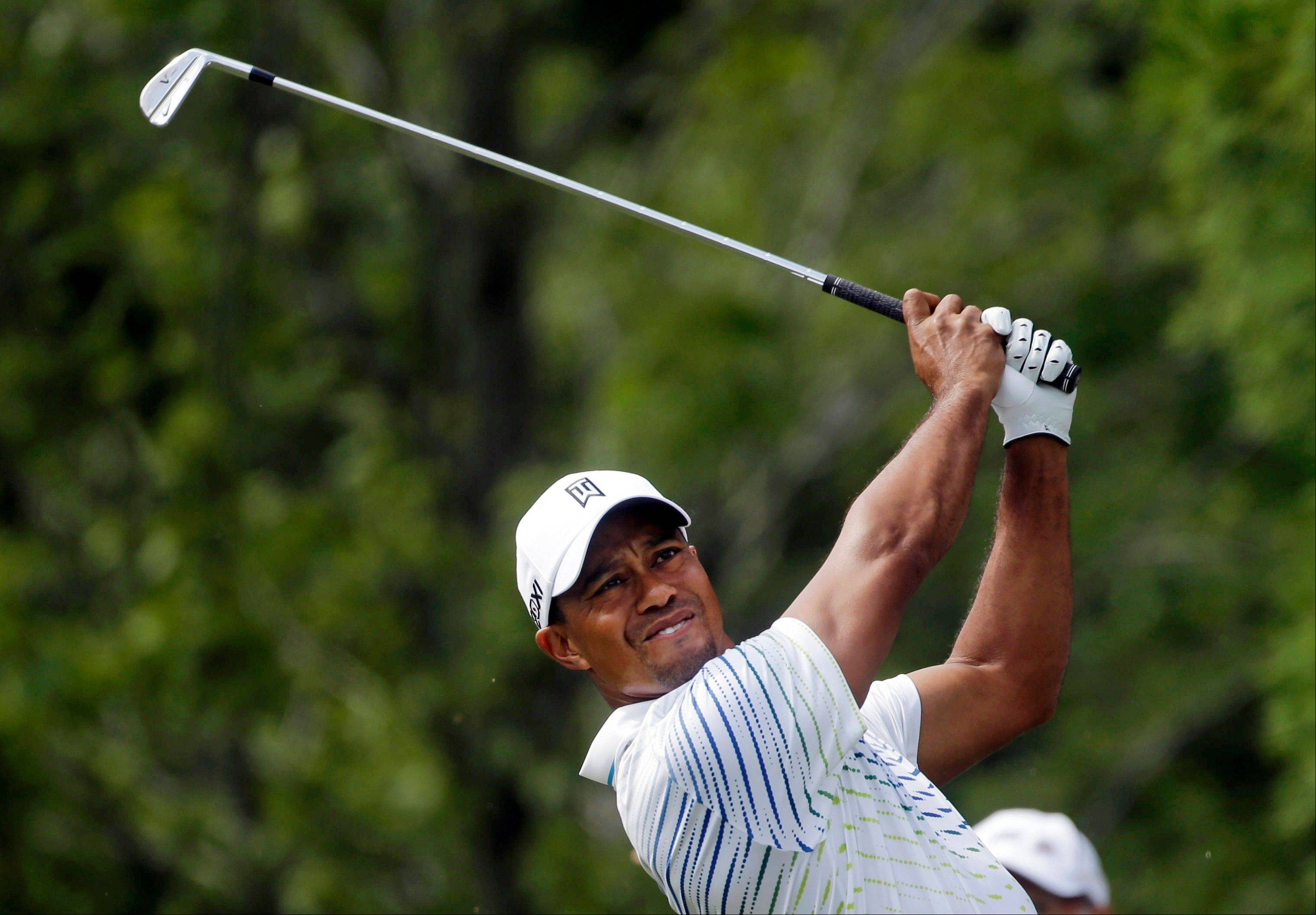Tiger Woods hits from the tee on the second hole Thursday during the first round of the Tour Championship in Atlanta.