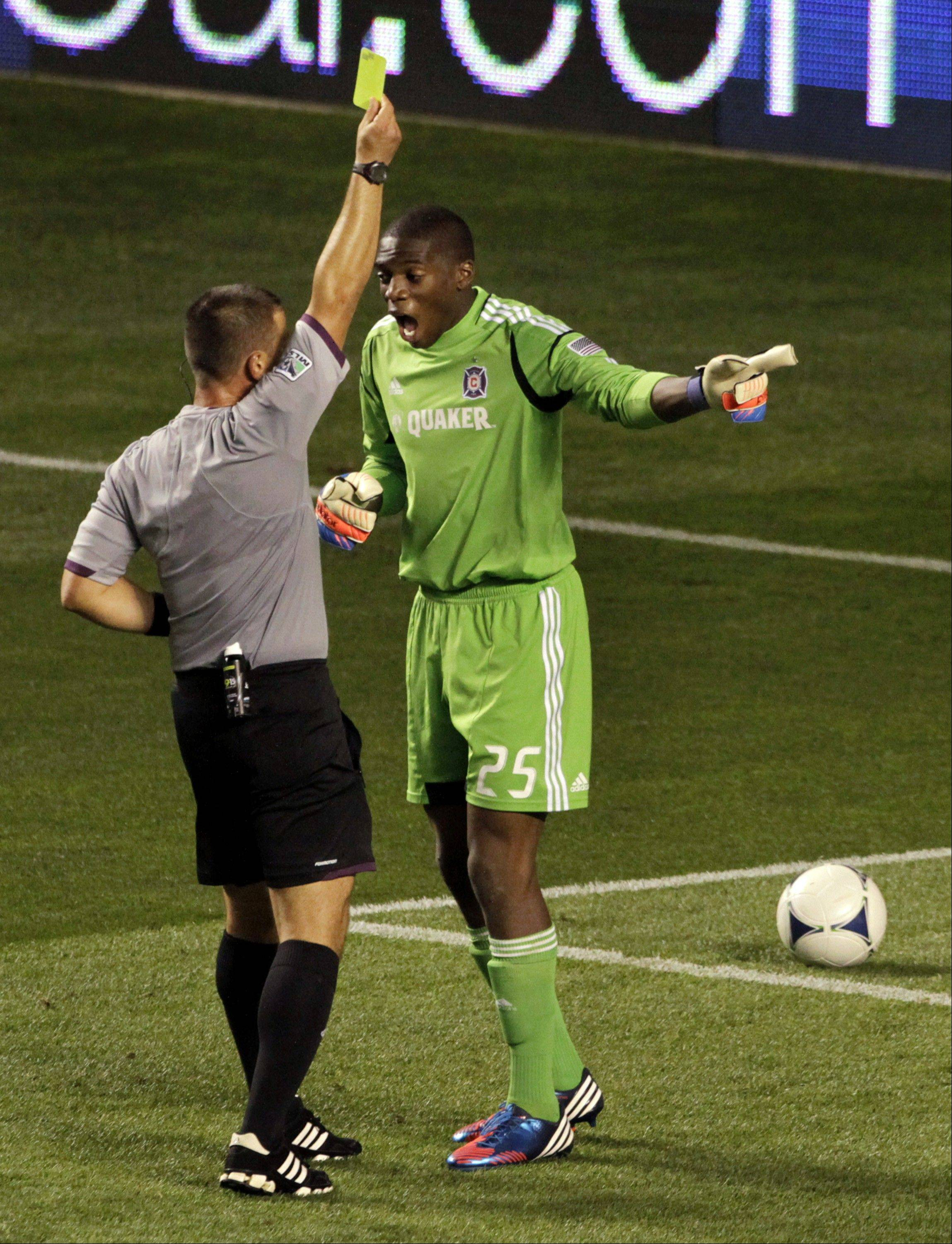 Chicago Fire goal keeper Sean Johnson, here arguing a yellow card call against the New England Revolution last month, has helped the Fire defense become one of the best units in Major League Soccer. While they've been winning close games, it has been more than two months since their last shutout.