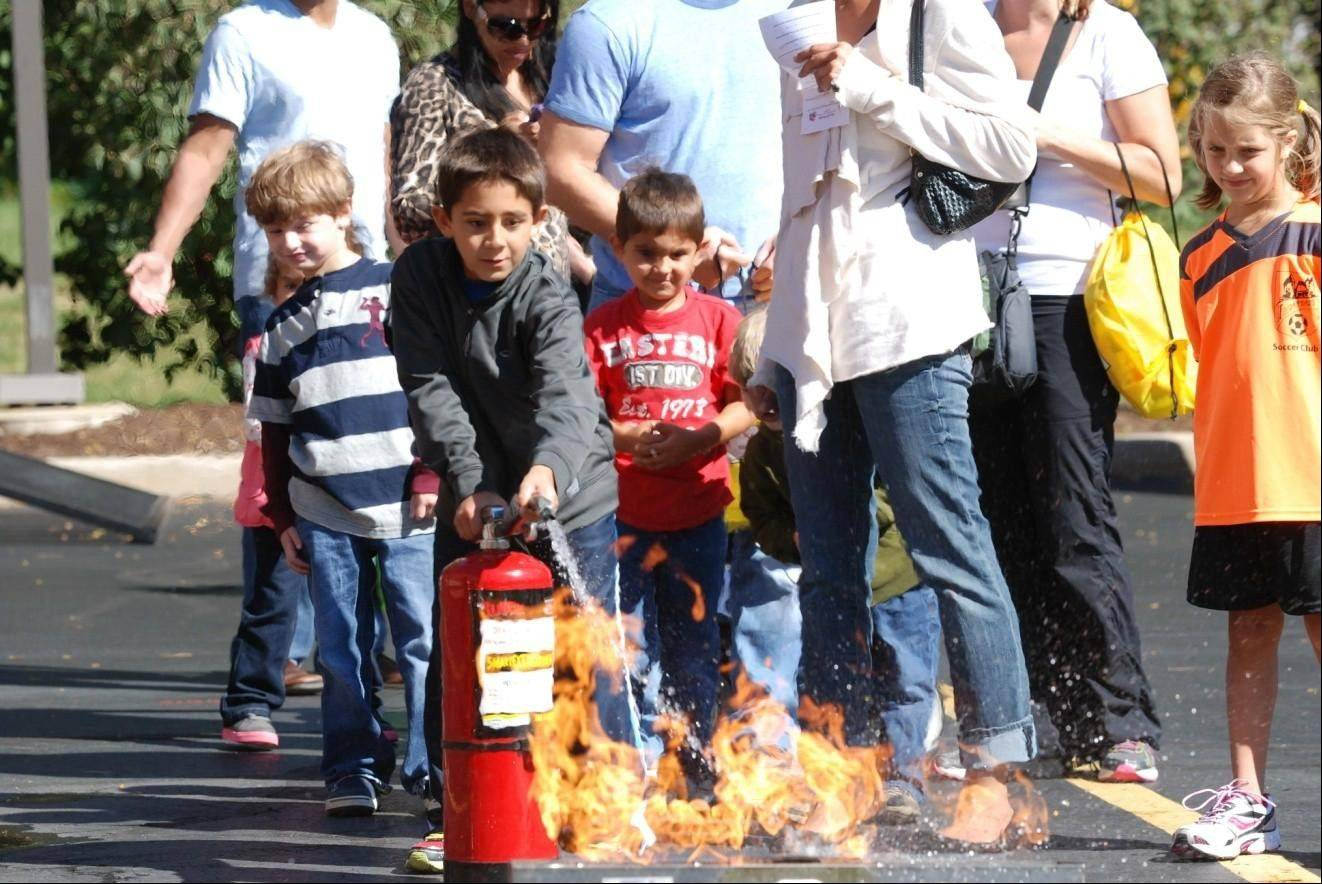 Children learn the proper procedures for fire extinguishment during the Palatine Rural FPD Open House Sept. 8.
