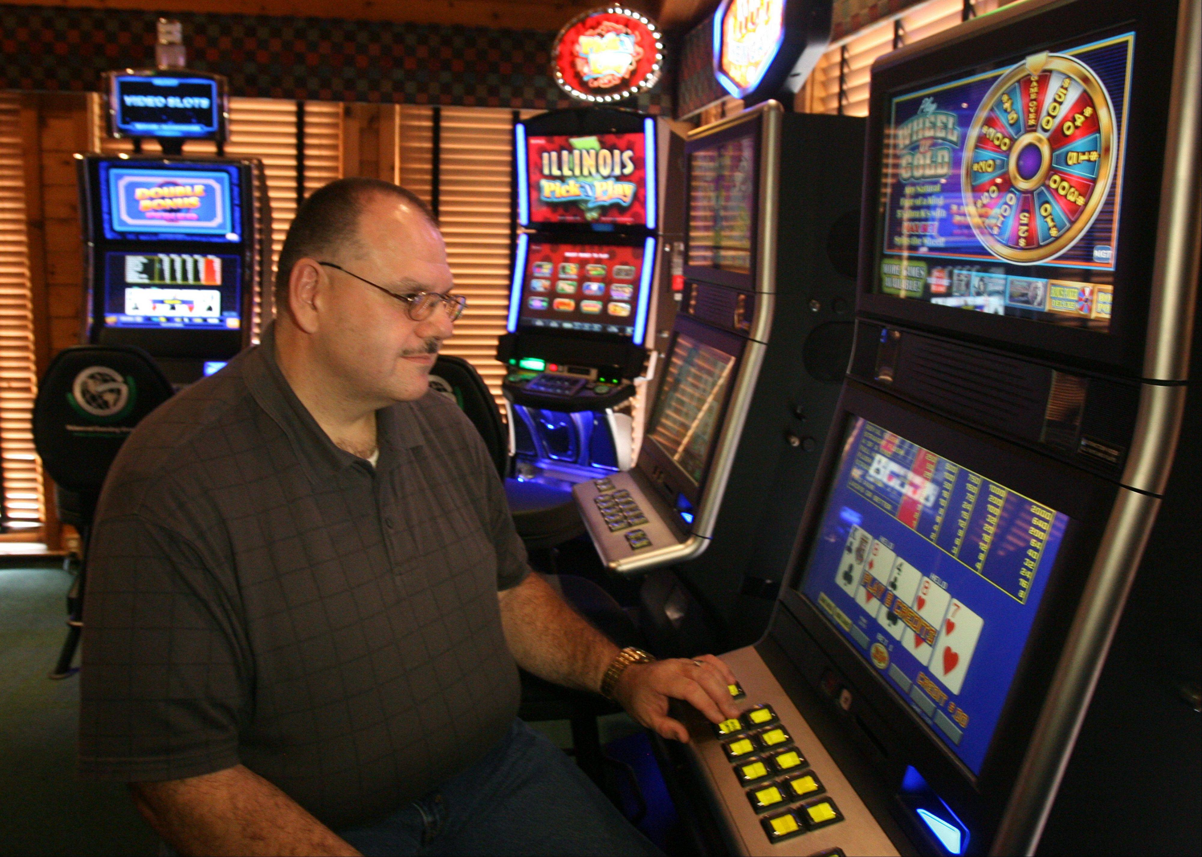 "Robert Franklin of Sapulpa, Okla., tried out one of the video gambling machines at The Assembly American Bar & Cafe in Hoffman Estates Thursday. He lost $6. ""I look at it like going to the movies, except that you can make some money,"" he said. ""If you don't have the money to lose, then don't play."""