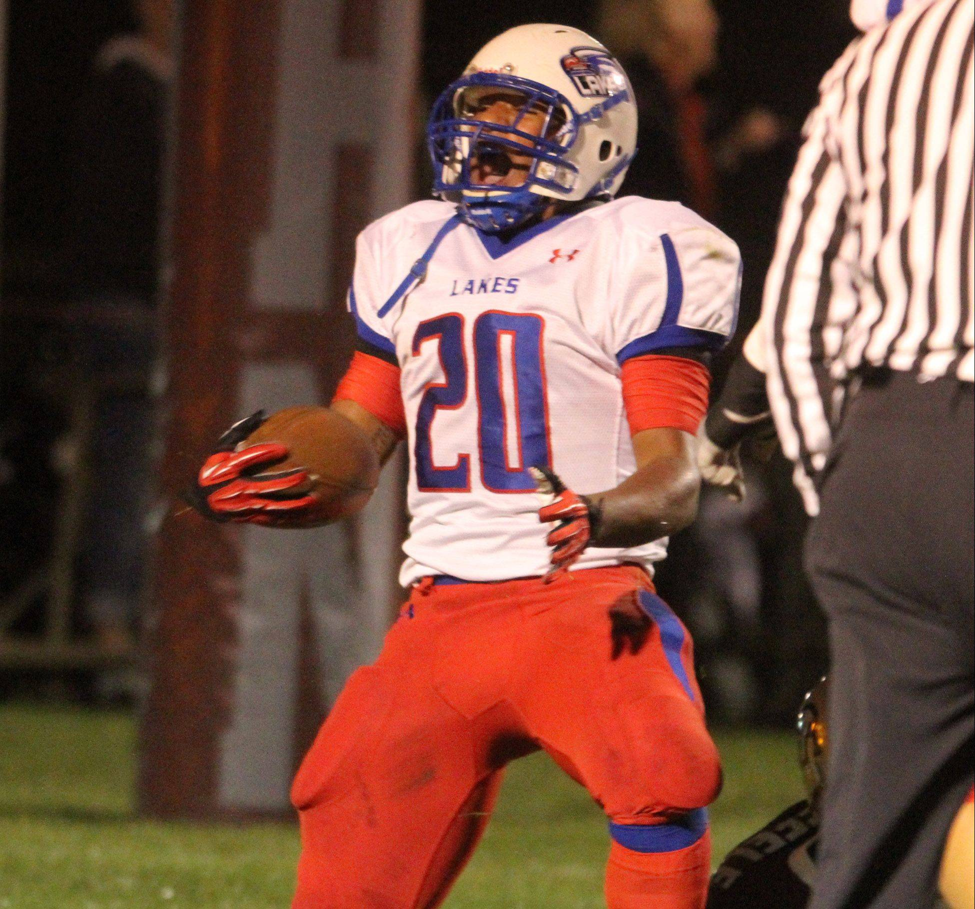 Lakes running back Direll Clark celebrates a first-quarter touchdown at Antioch on Friday.