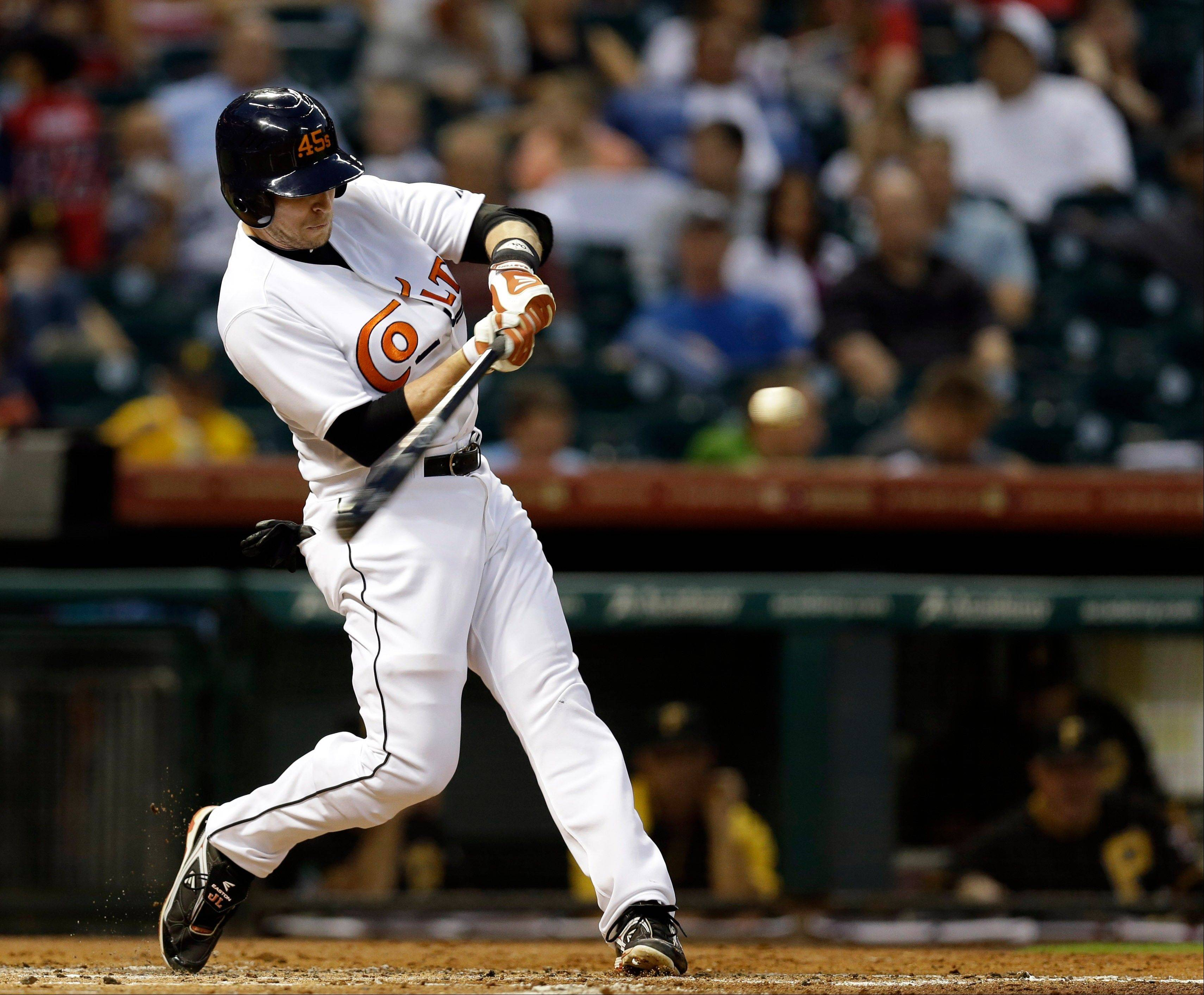 The Astros' Jed Lowrie hits a three-run home run during the first inning Friday against the Pittsburgh Pirates in Houston.