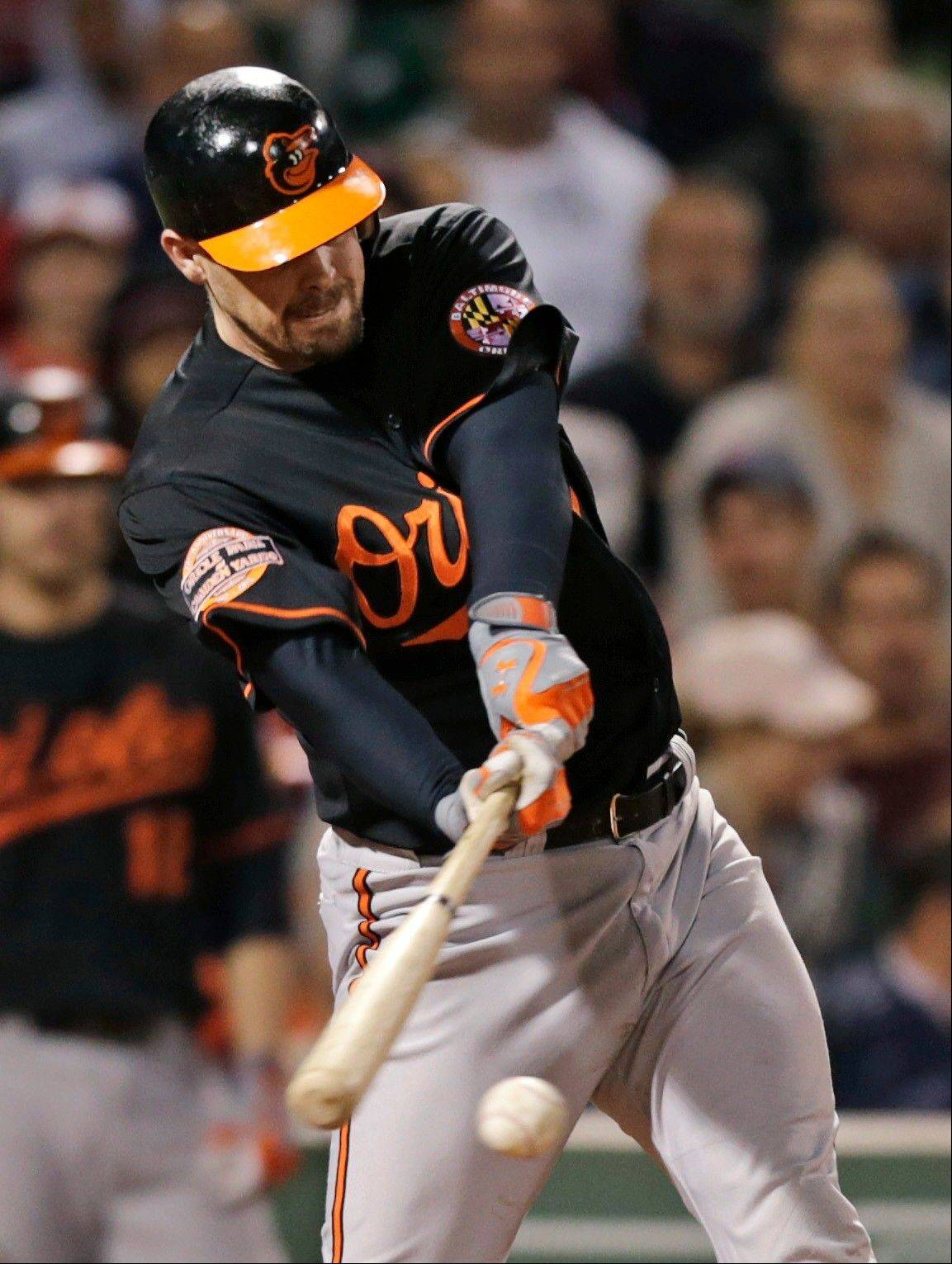 Baltimore's Matt Wieters connects on a two-run single in the fourth inning Friday in Boston.