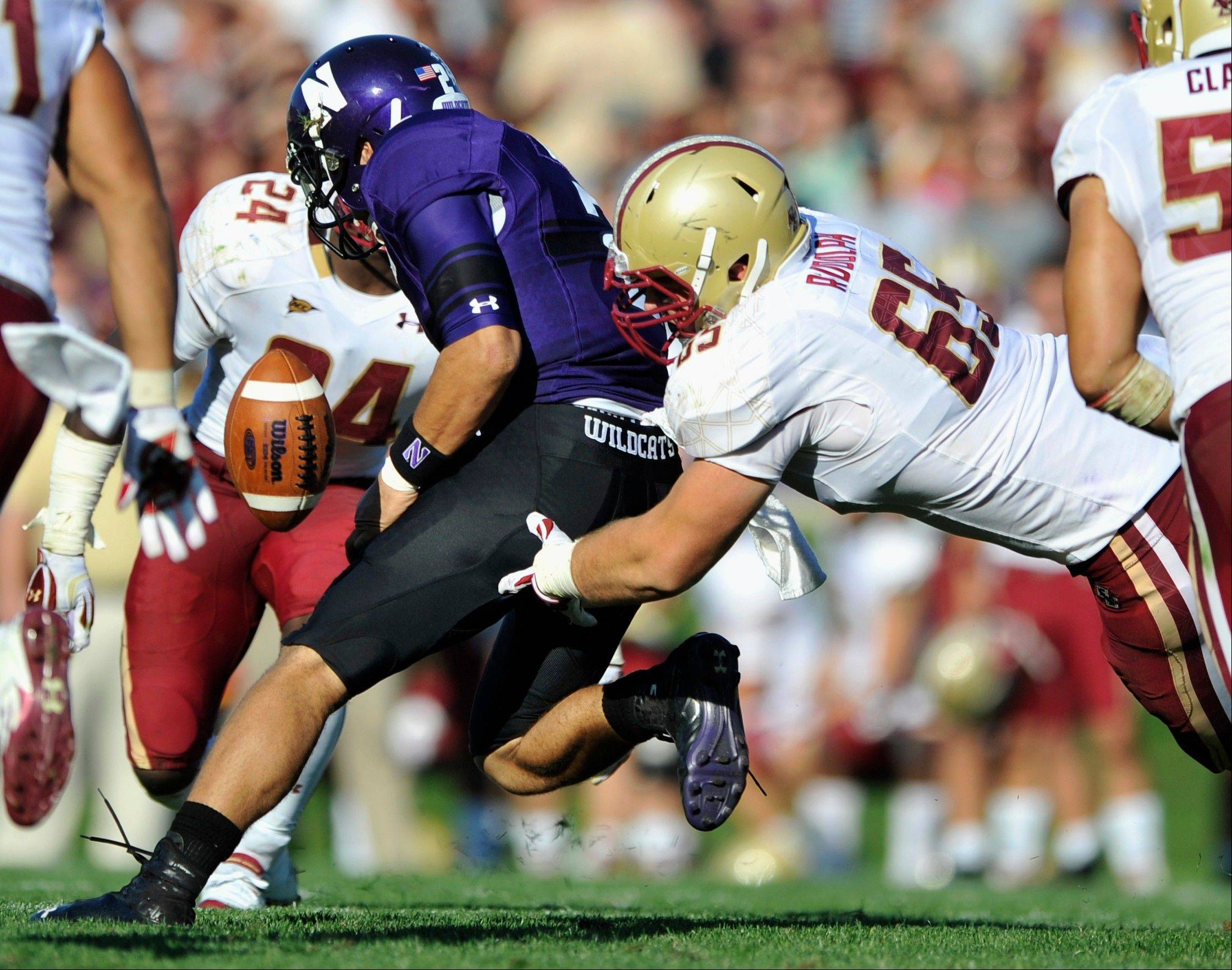 Boston College's Jaryd Rudolph forces Northwestern quarterback Kain Colter to fumble during the third quarter last Saturday in Evanston.