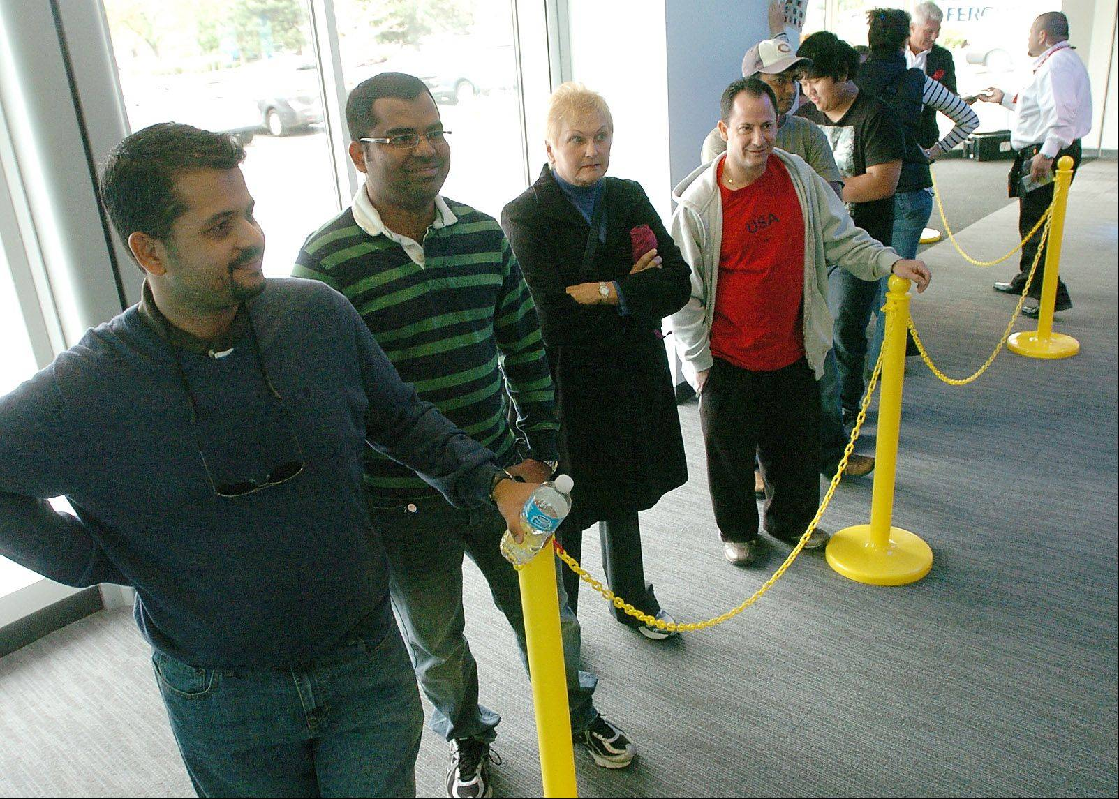 Anantha Subramanya of Wheeling, left, and Sanjeeva Kanduri of Arlington Heights wait in line to buy the new iPhone 5 the AT&T Store in Arlington Heights.