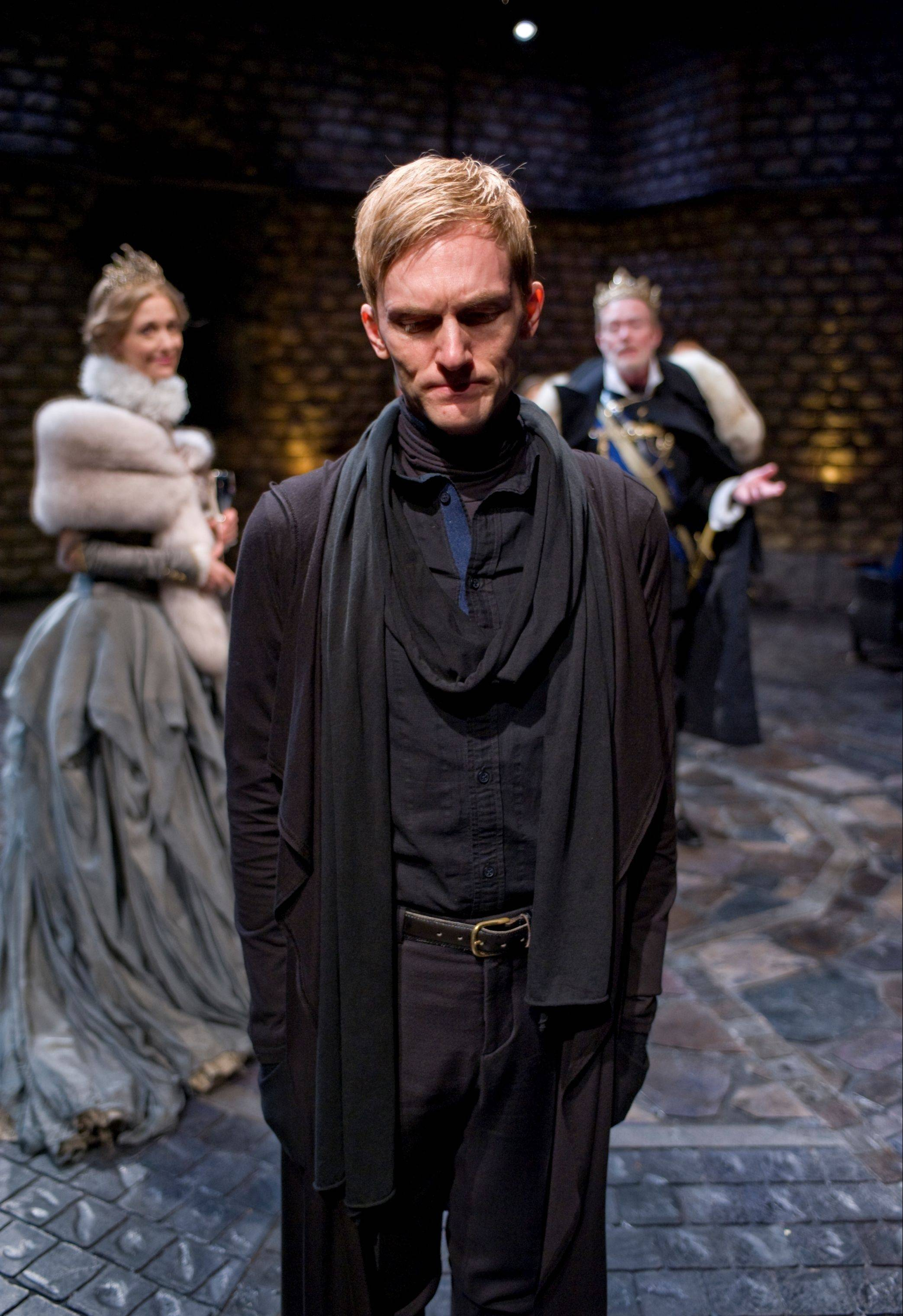 Scott Parkinson, center, is riveting as Hamlet in the Writers' Theatre production, which also stars Shannon Cochran as Gertrude and Michael Canavan as Claudius.